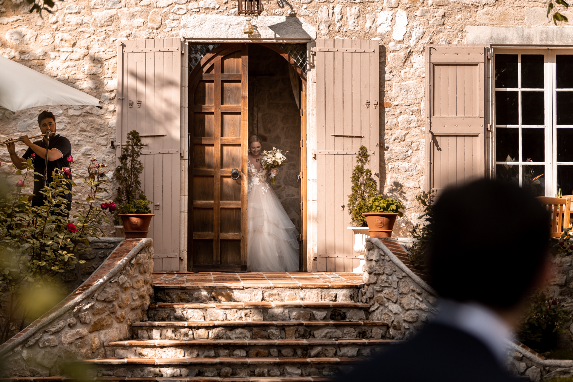 Chateau Brametourte, Lautrec, Tarn, Wedding Venue Image | The bride arrived for the ceremony while a musician played the flute
