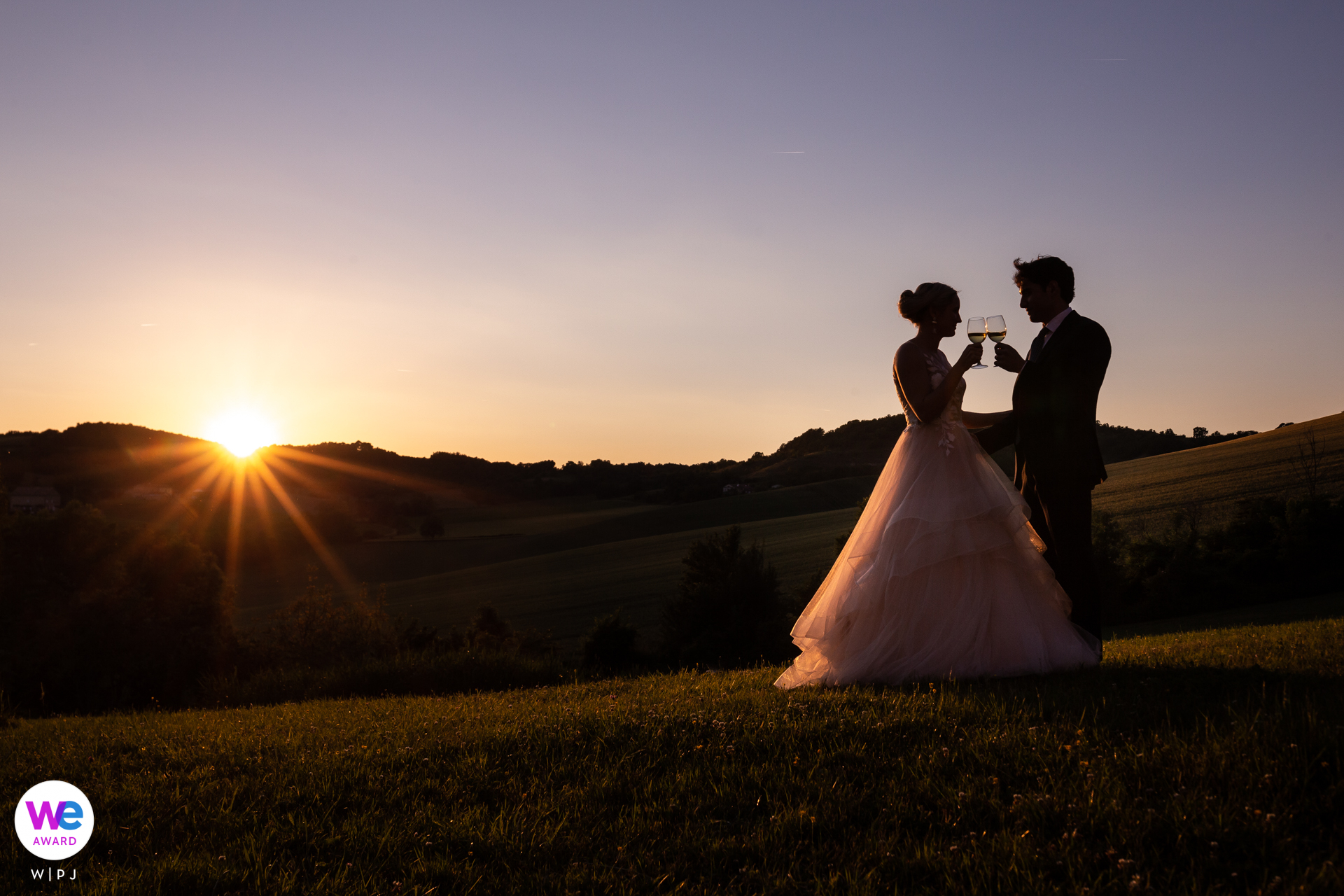 Chateau Brametourte Wedding Couple Portrait | The bride and groom toast one another and their new marriage