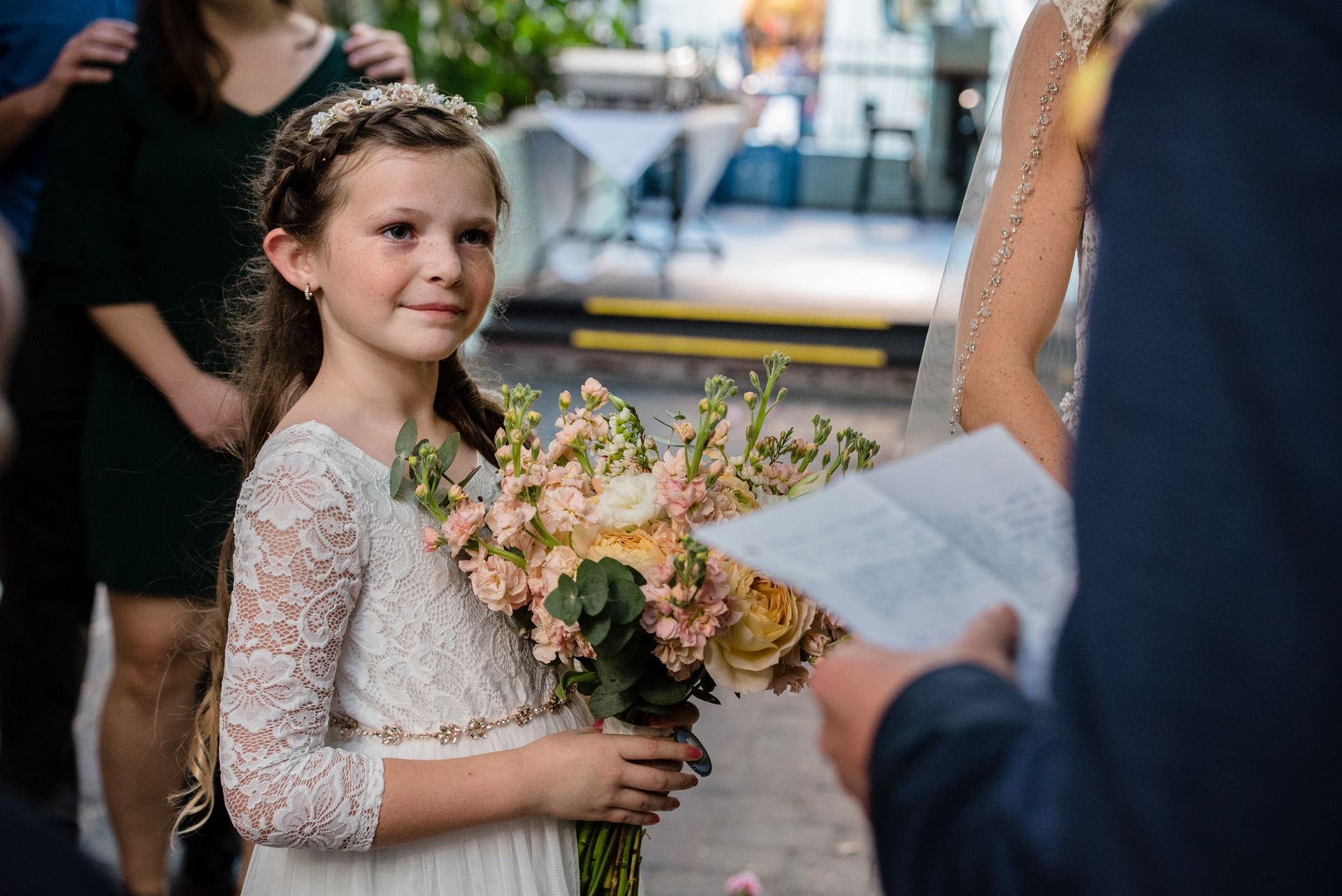 Florida Wedding Photography in Key West | The flower girl looks at her mom with both admiration and approval