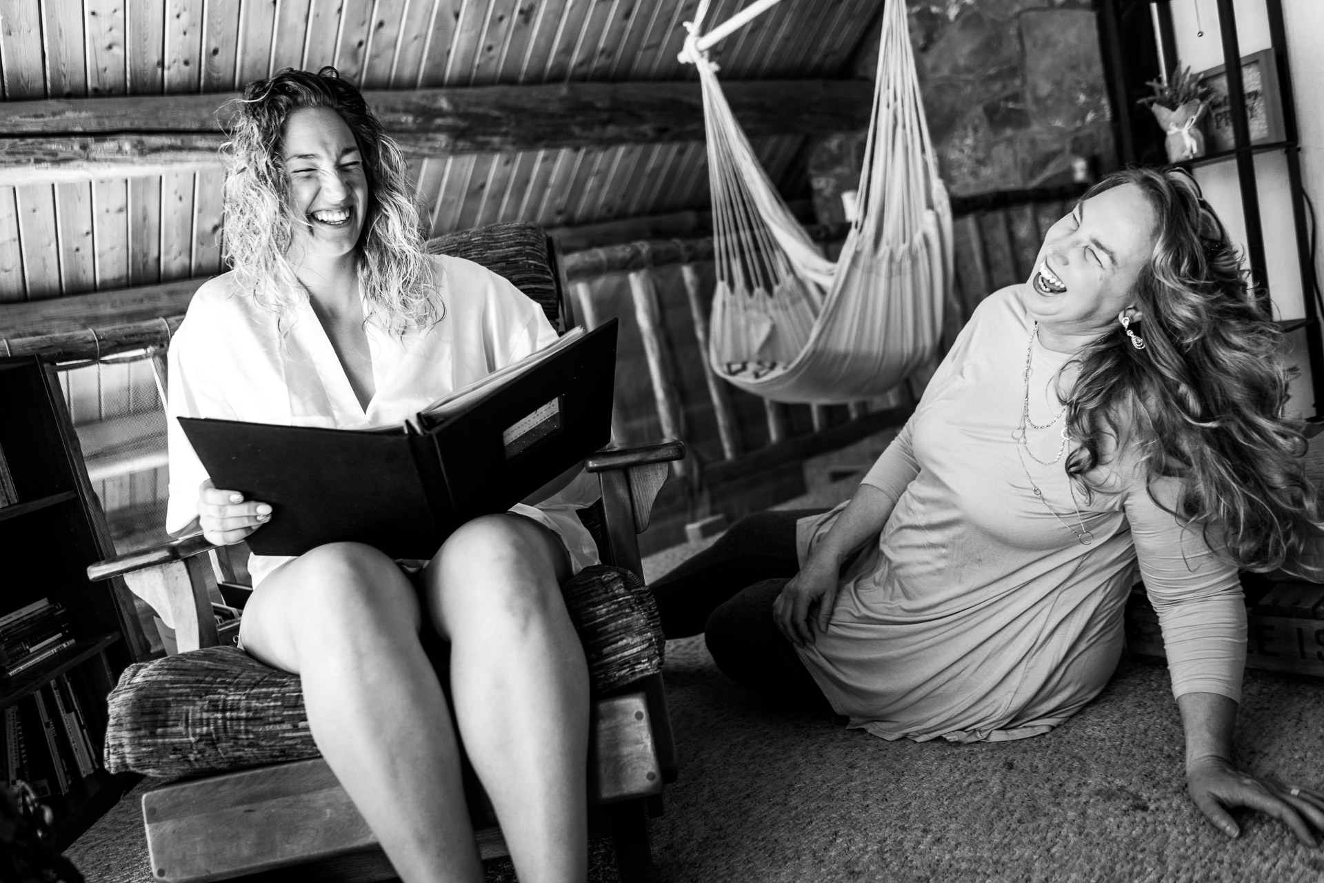 Pagosa Springs, Colorado Snow Wolf Lodge Wedding Pic | The bride and her mom share a laugh as they read through stories in a scrapbook