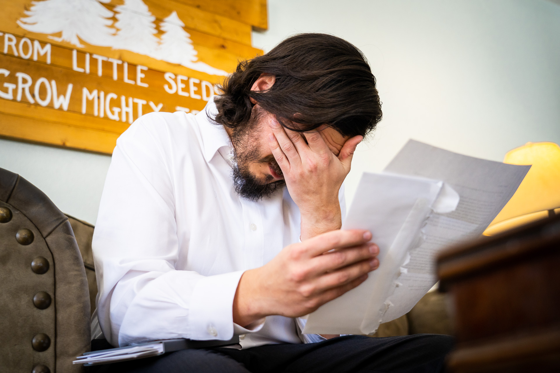 San Juan National Forest - Southwest Colorado Wedding Image | The groom wipes away tears as he reads letters