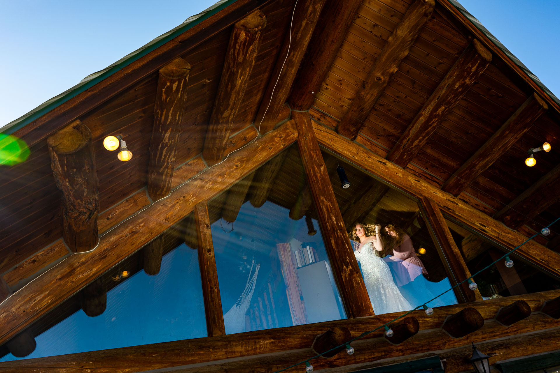 Snow Wolf Lodge, CO Wedding Day Photography | Brides mother helps her into her gown