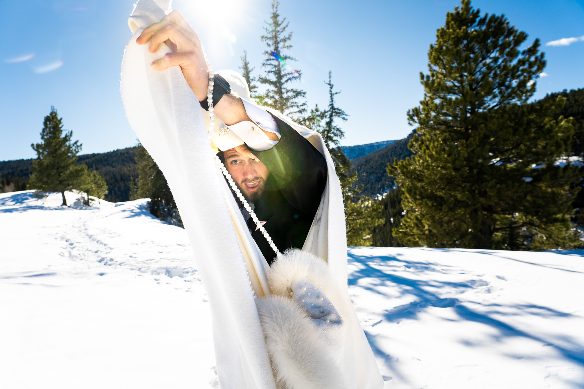 Piedra Canyon Overlook, CO Winter Snow Wedding Picture | a first-look trick on the groom