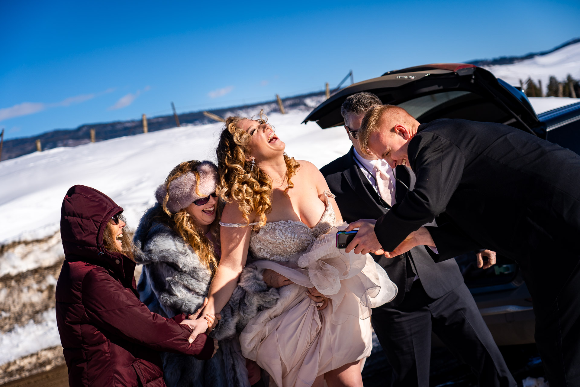 Piedra Canyon Overlook Wedding Photography | The bride laughs after watching a video that showed the groom surprised to see his brother