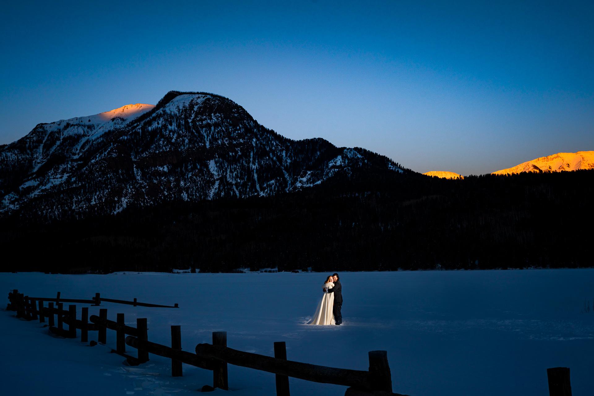 Williams Creek Reservoir - Colorado Wedding Couple Portrait | The couple pose for a blue hour portrait