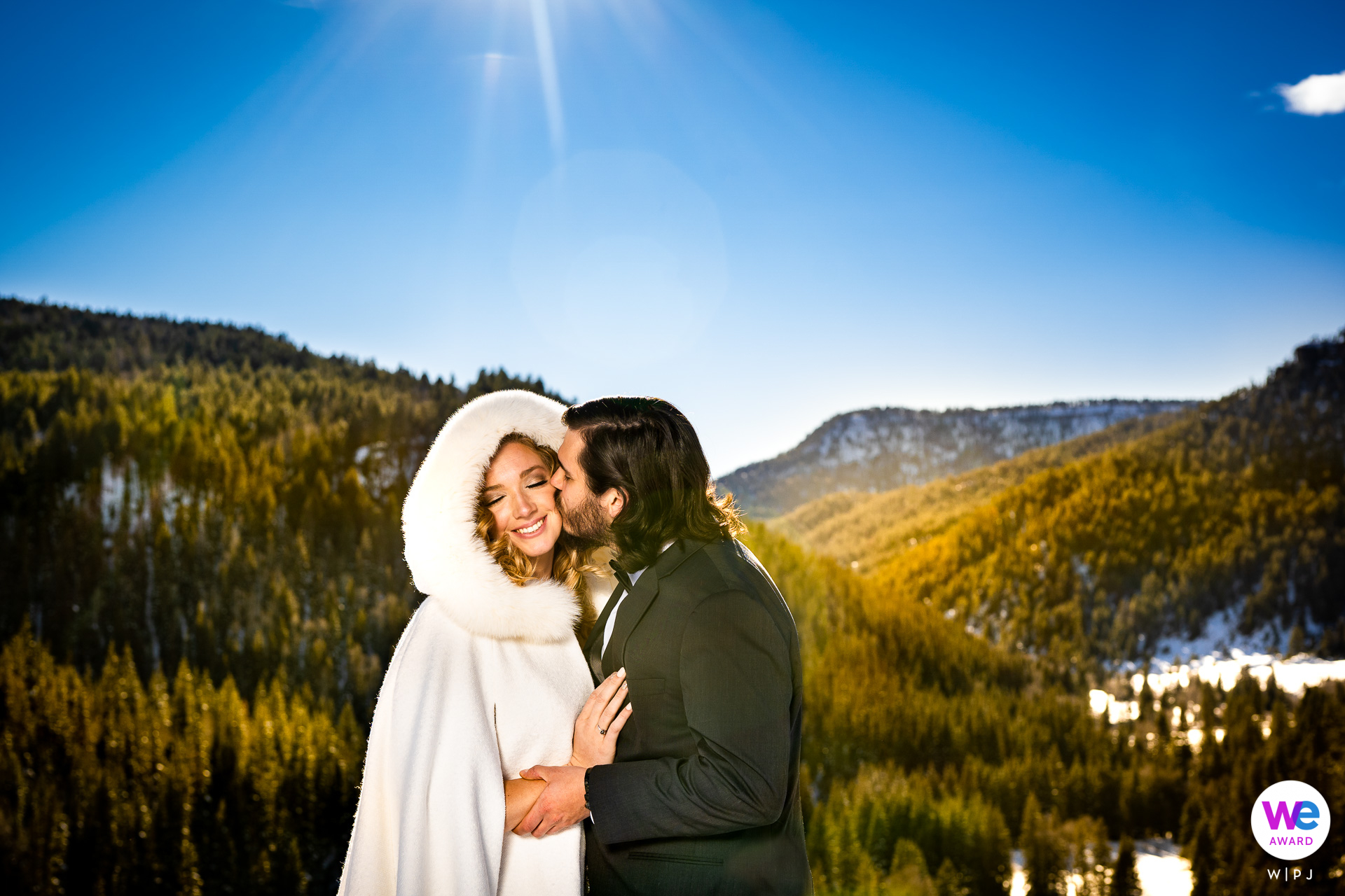 Pagosa Springs, CO Wedding Photographers | The groom kisses the bride during their first look at Piedra Canyon Overlook