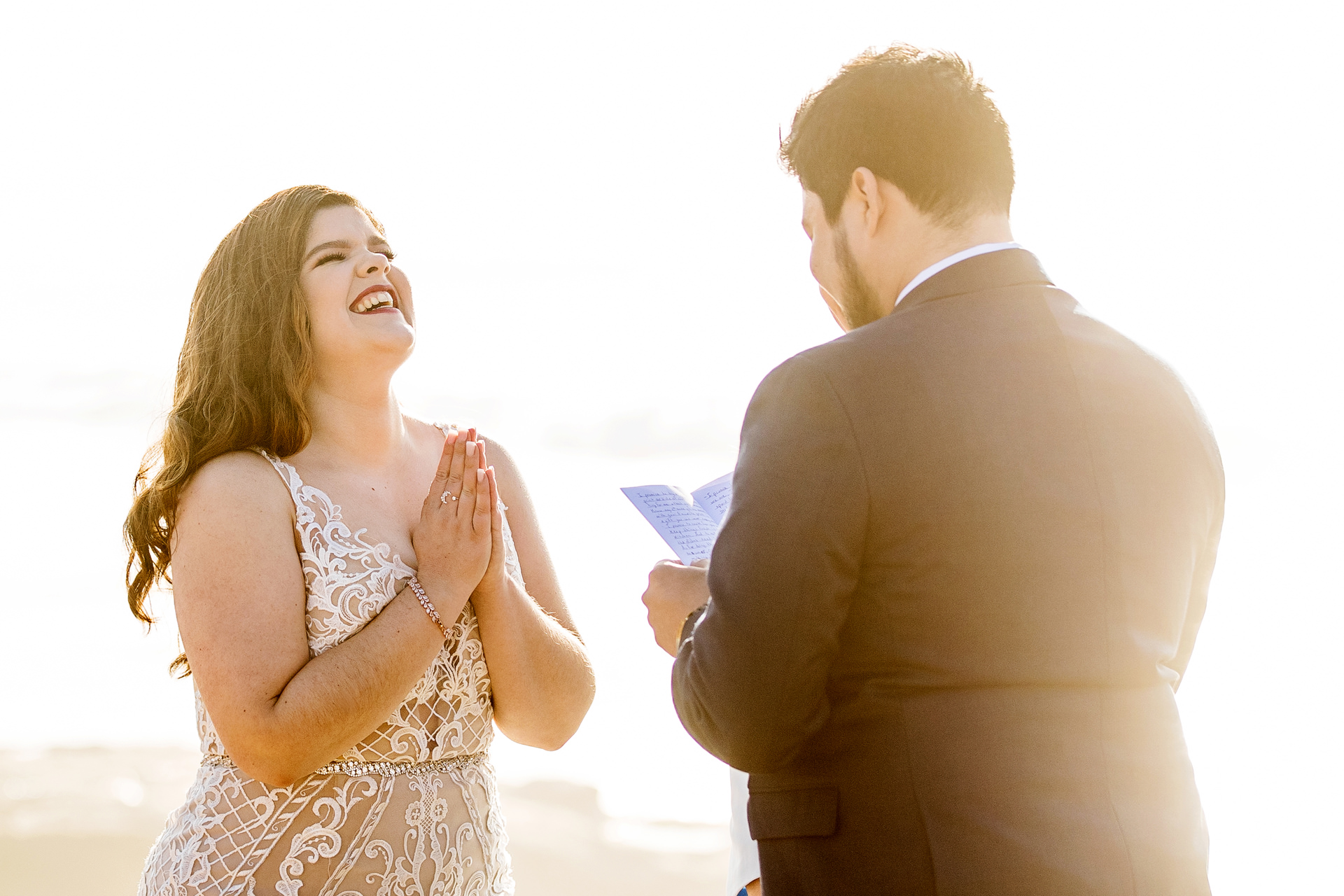 Beautiful Wedding Photography at Sunset Cliffs - San Diego, CA | The bride reacts with joy and laughter to grooms vows
