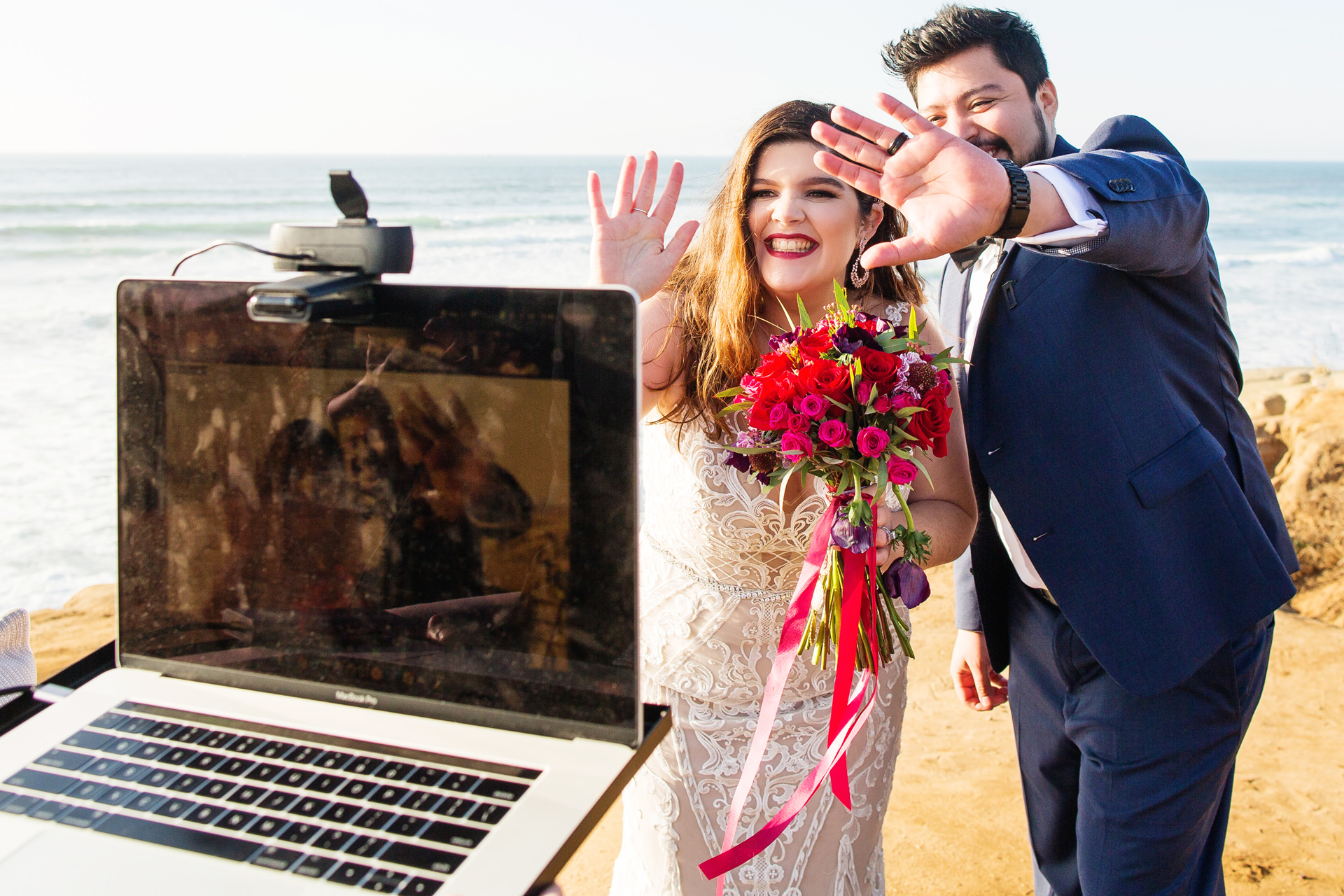 Wedding Photos from Sunset Cliffs, San Diego | they took time to wave hello to everyone who signed onto the live stream
