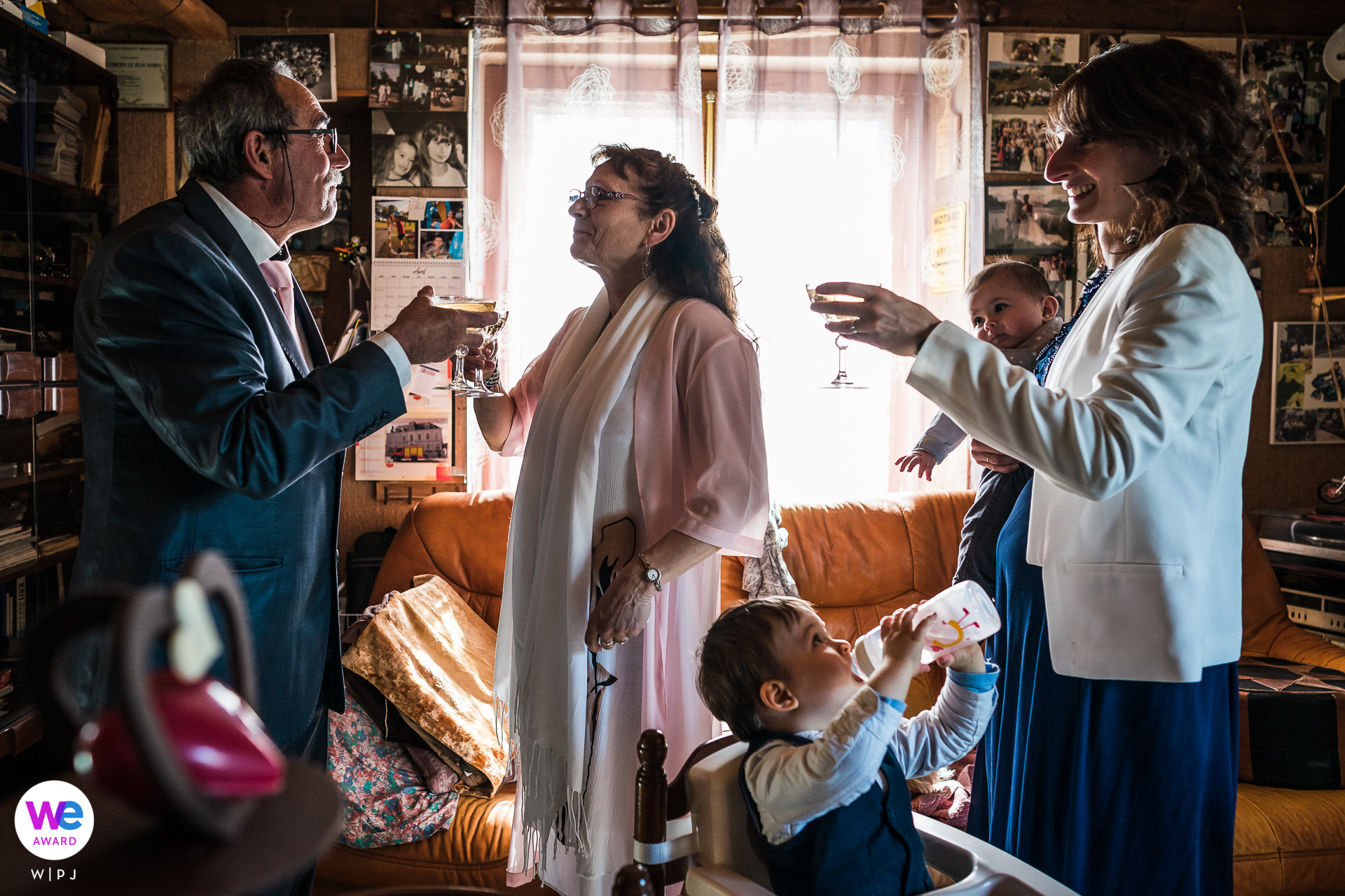 Central France Wedding Reception Image from Home | The couple toasts one another