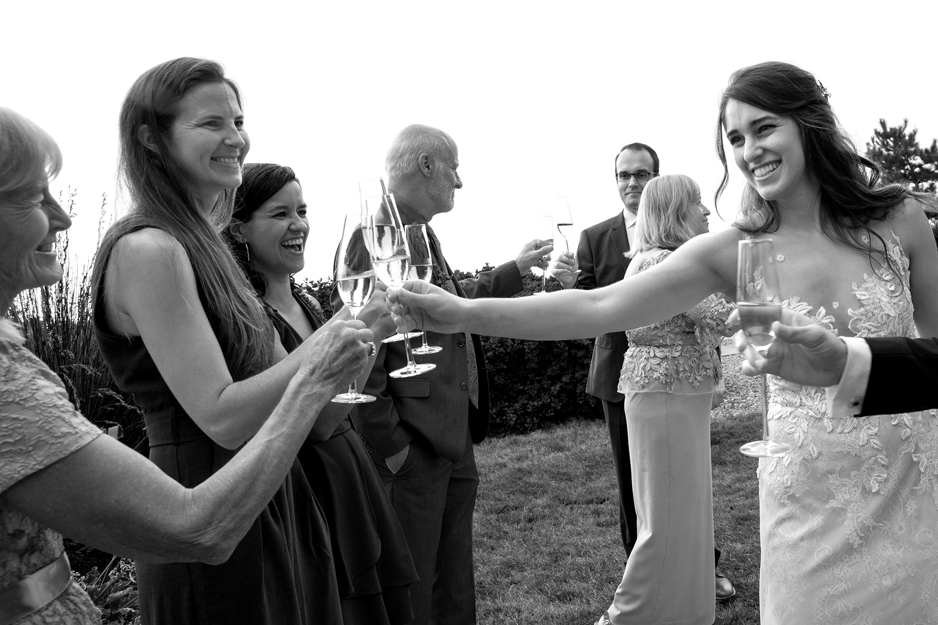 Wind and Sea Estate Wedding Photographer | Big Sur couple shares a celebratory champagne toast