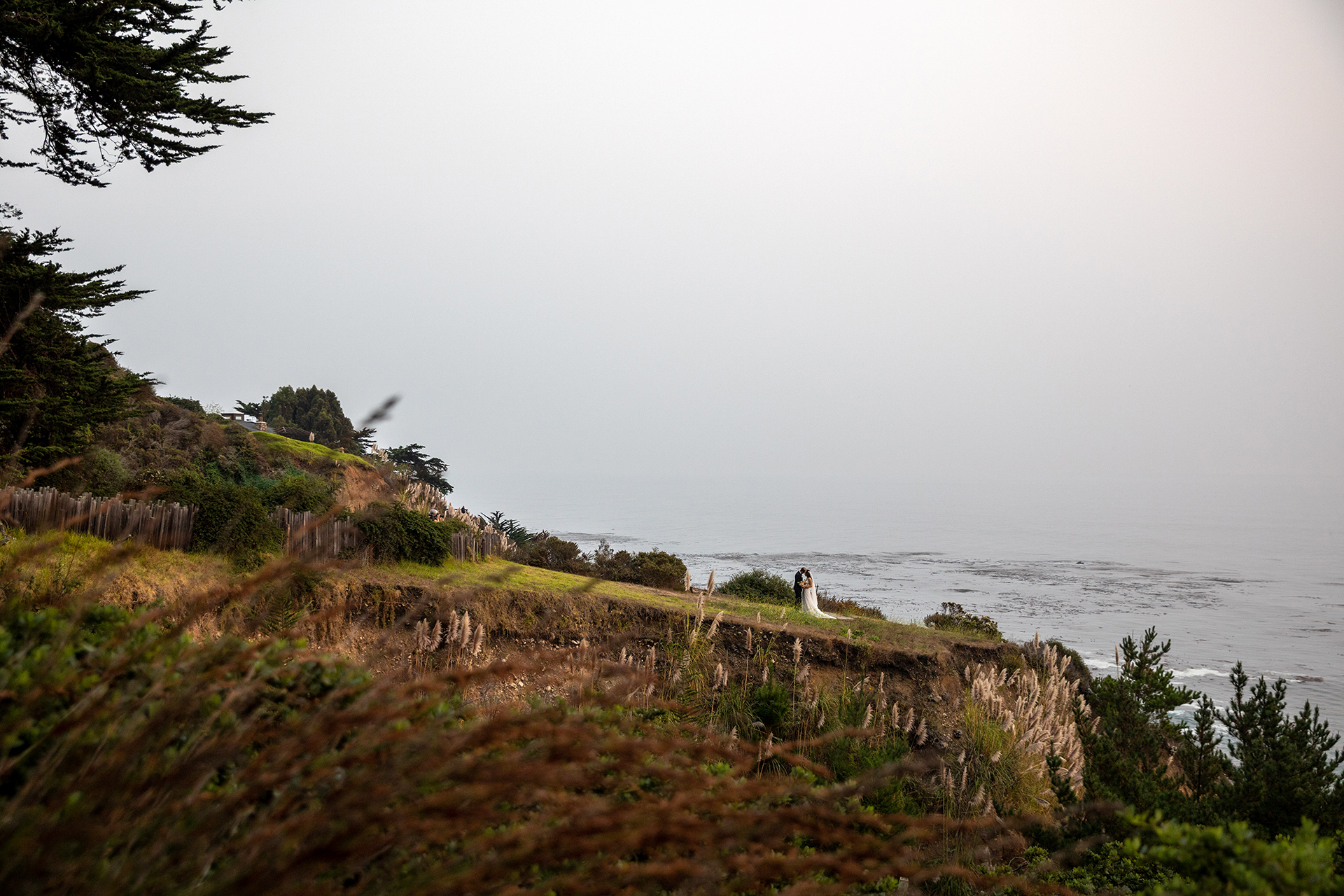 Wind and Sea Big Sur Wedding - CA Couple Portraits | The bride and groom spend a solitary moment enjoying their surroundings