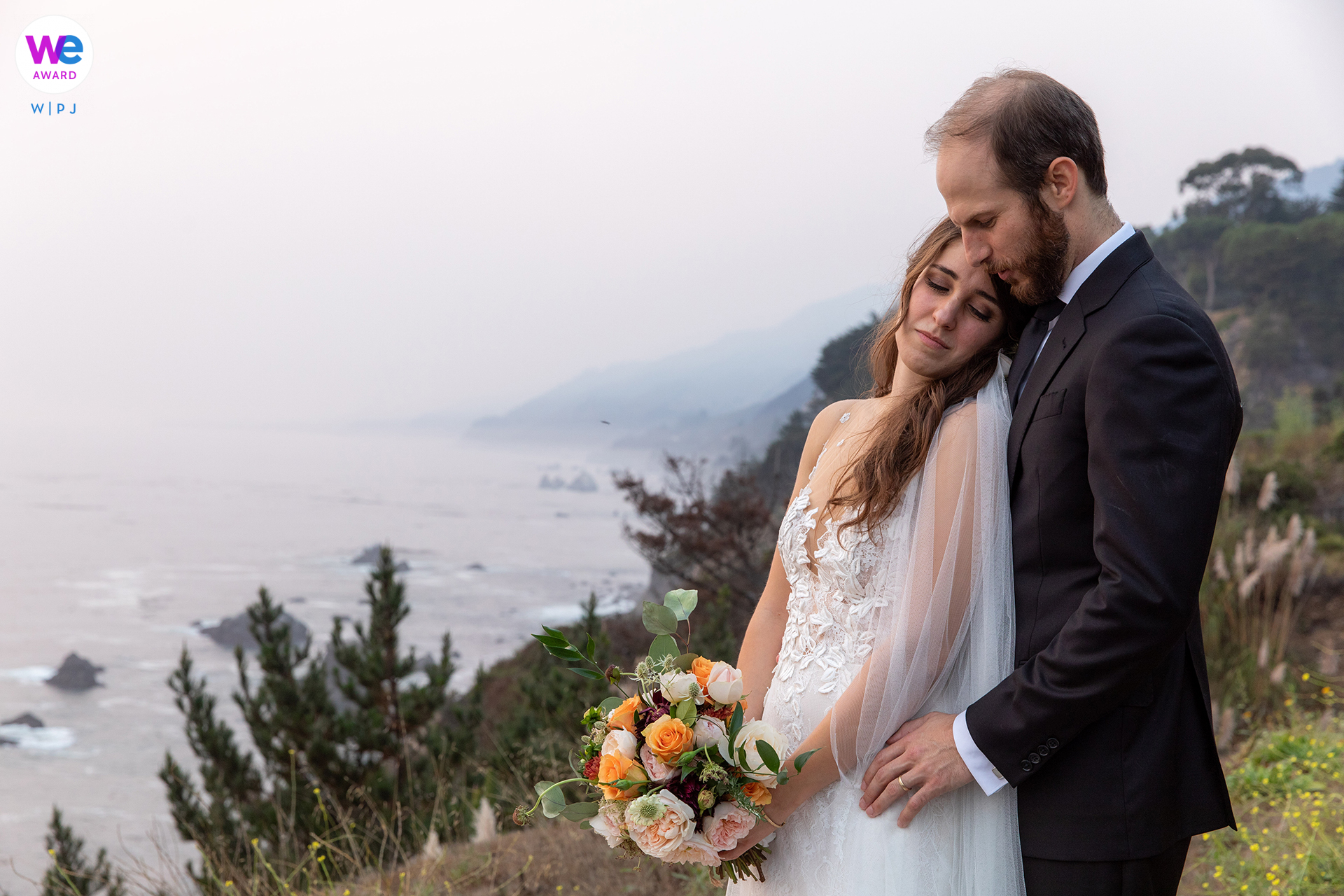 Wind and Sea Big Sur Wedding Photographer, CA | The bride and groom pose for a powerful, emotion-filled portrait