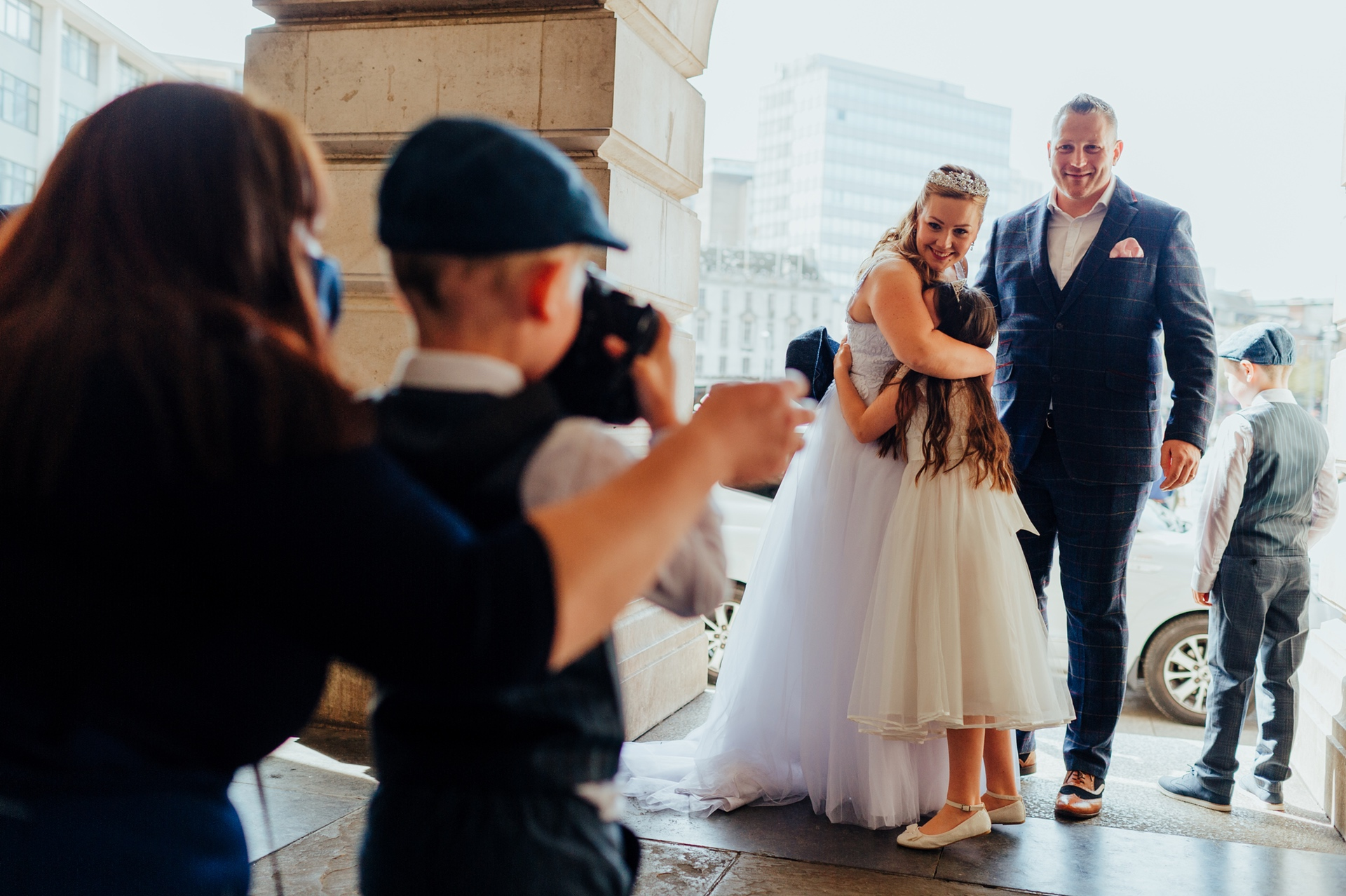 Nottingham Council House, UK Photography | The bride gives her young bridesmaid a hug