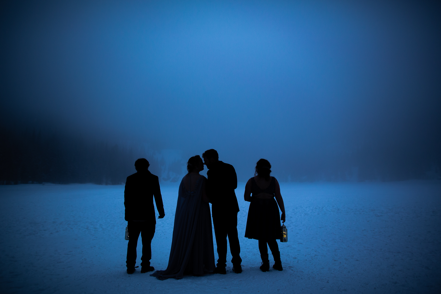 Estes Park Wedding Photographer   A portrait of the couple silhouetted against the foggy lake