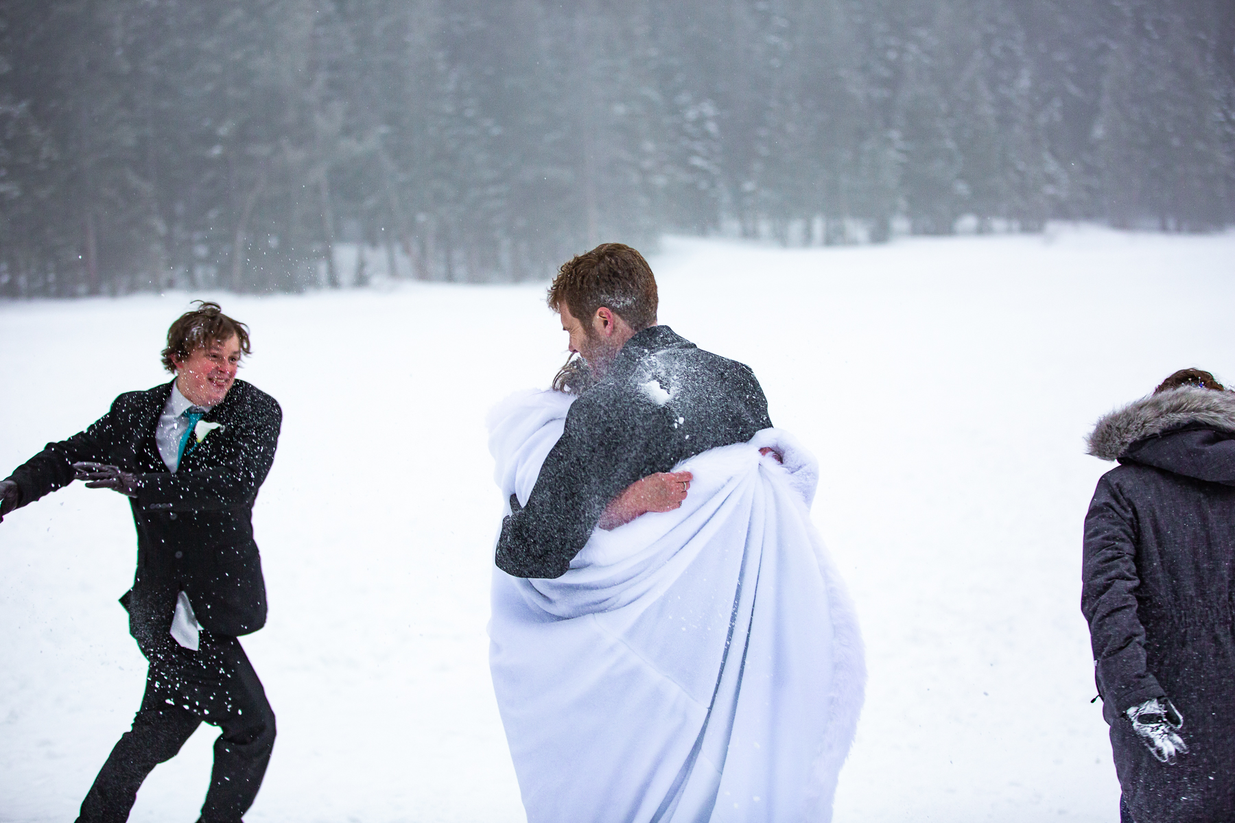 Estes Park, CO Wedding Photographers   The kids attack the couple with snowballs