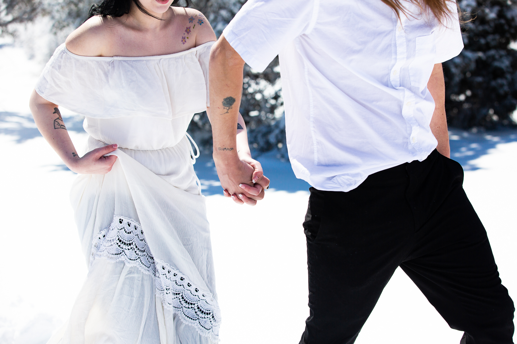 Colorado Photographers for Mountain Weddings in the Snow | The groom takes his wife's hand
