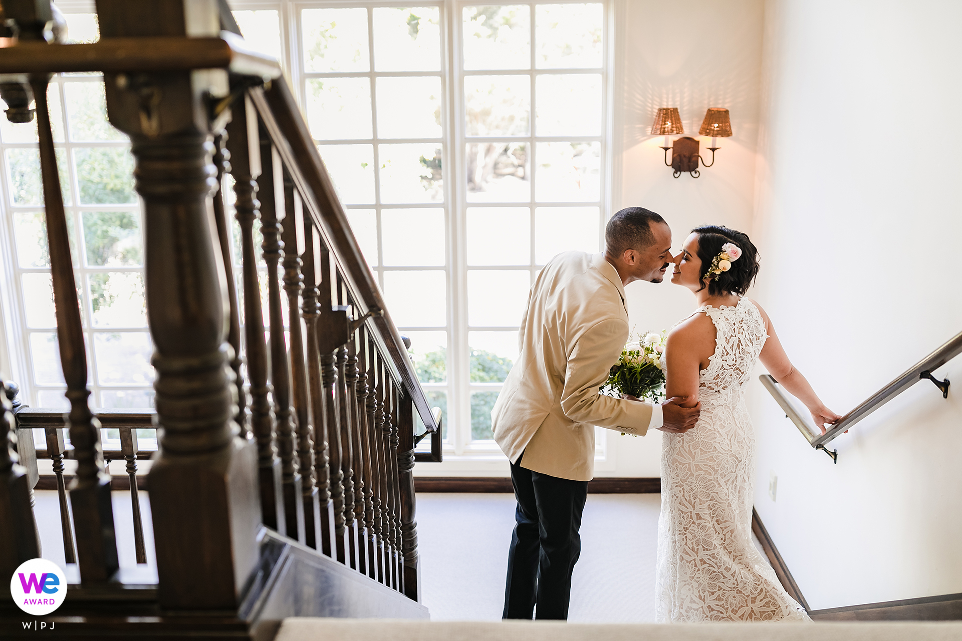 Wedding Photography from Seal Cove Inn | The groom steals a quick yet passionate kiss from his soon-to-be bride