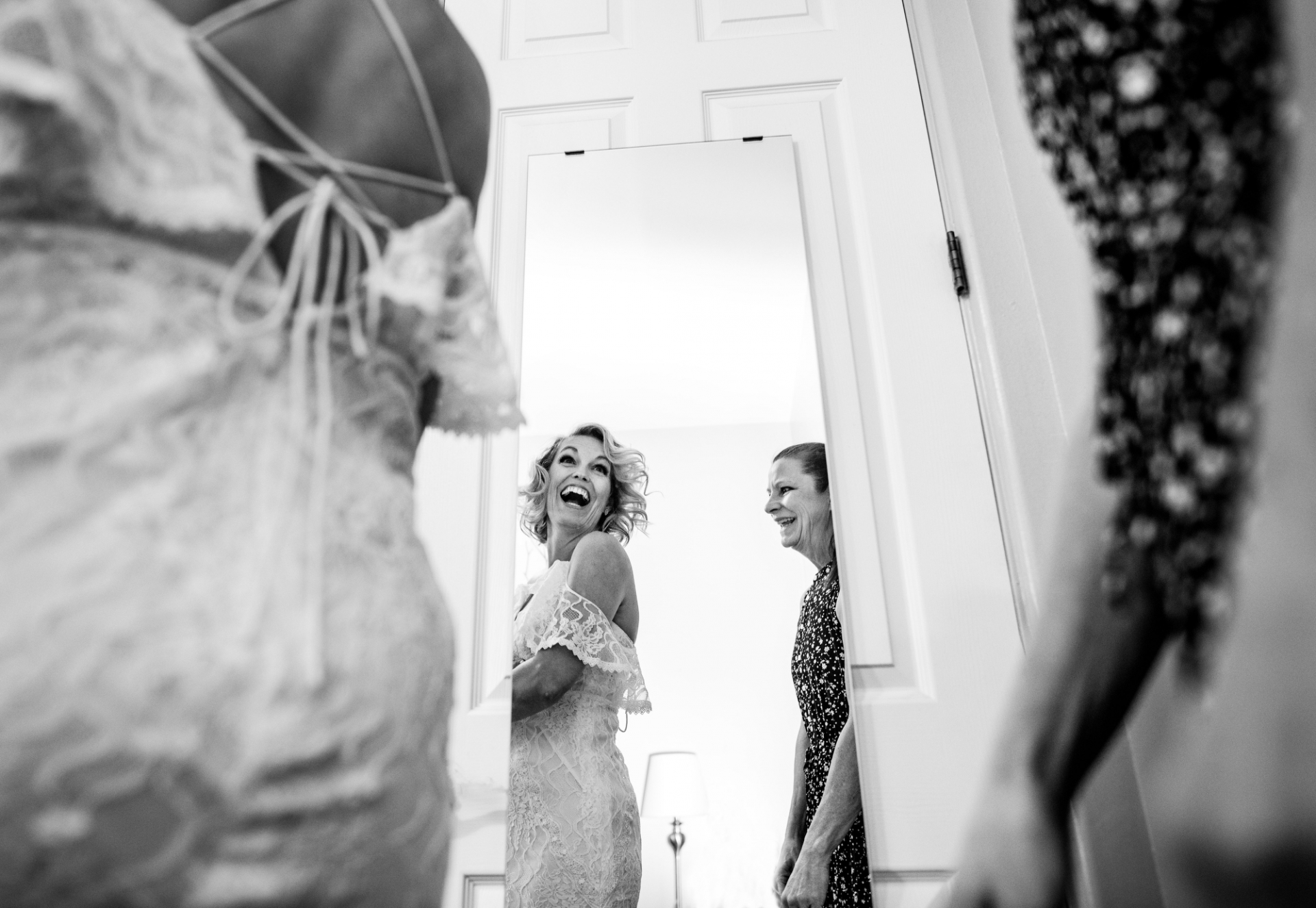 Desert Botanical Garden - Smaller-Size Wedding Pictures | The bride cries out in delight as she sees her bridal look reflecting back at her
