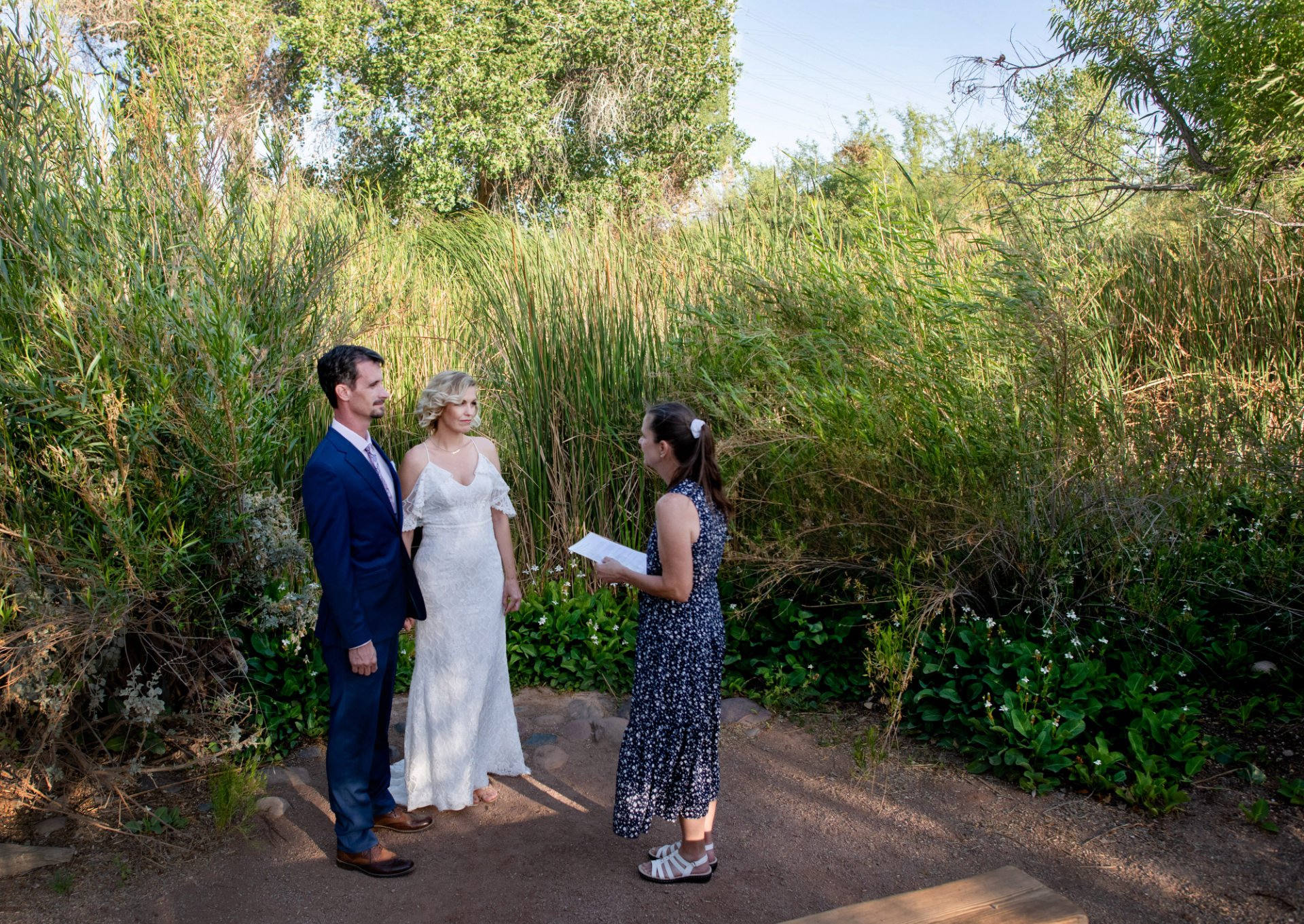 Phoenix Wedding Photography from Desert Botanical Gardens | Tucked away in a quiet corner along the trail, the bride and groom say their vows in privacy