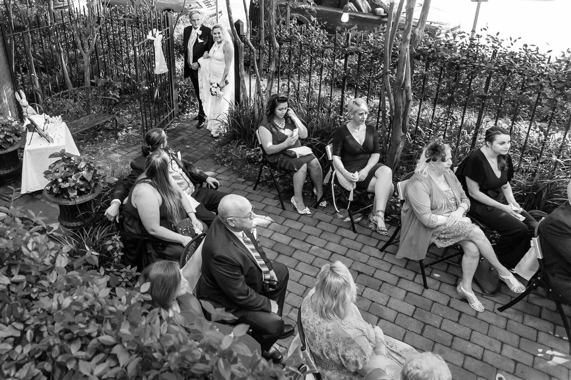 Kehoe House Wedding Image from Savannah | Dad escorts her to the garden courtyard