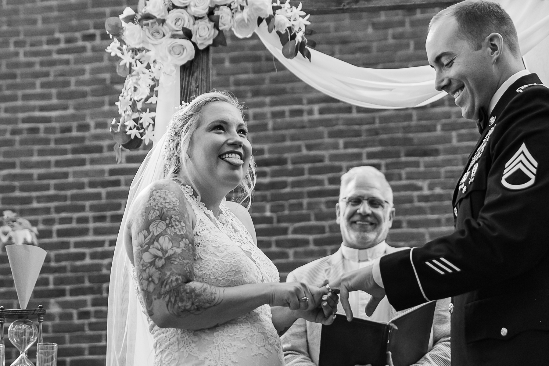 Savannah Wedding Ceremony Photo Gallery | The bride has a little trouble getting the wedding ring on