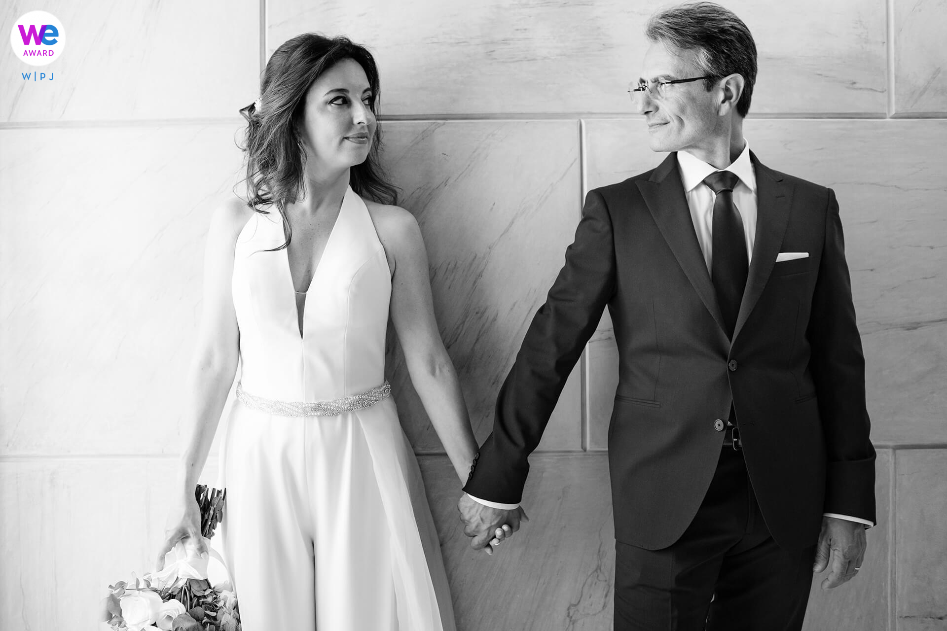 Legal Wedding Portrait at Palazzo Platamone, Trapani | The loving look of the newlyweds hand-in-hand
