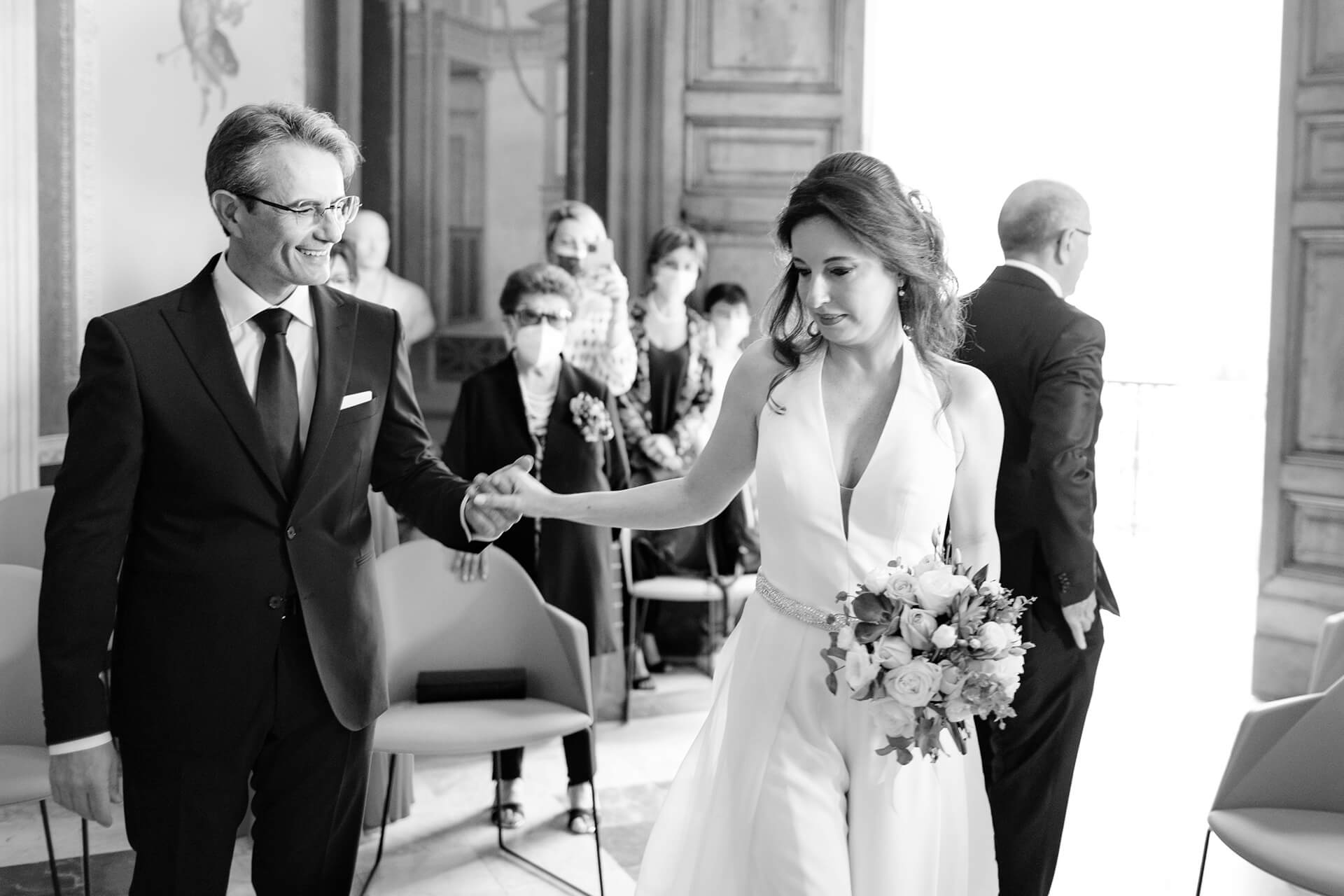BW Wedding Photographer Italy | The groom welcomes his bride as a true gentle man