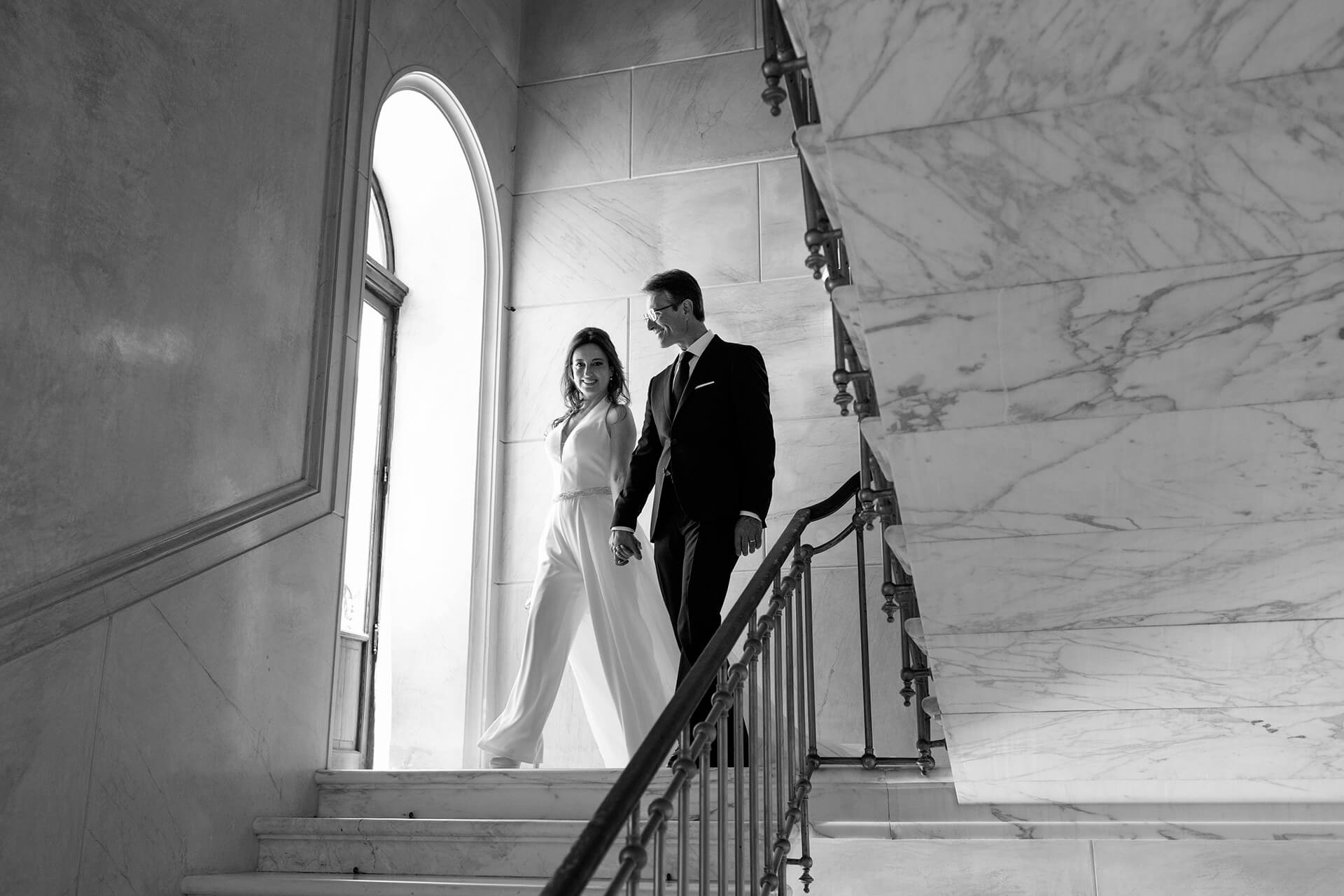 Palazzo Platamone, Trapani Wedding Photography | Black and white image of the newlyweds descending the stairs