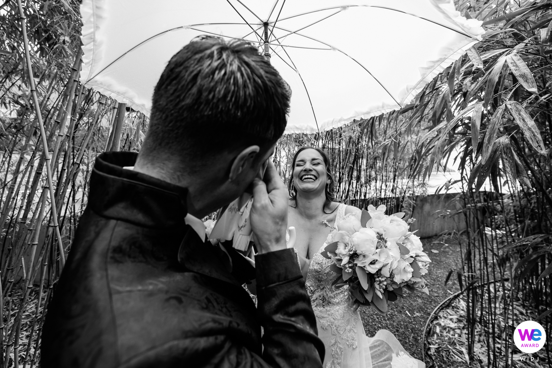 Wedding photography from Switzerland, at Rapperswil Castle | The bride is Wearing a glittering gown and carrying an elegant parasol