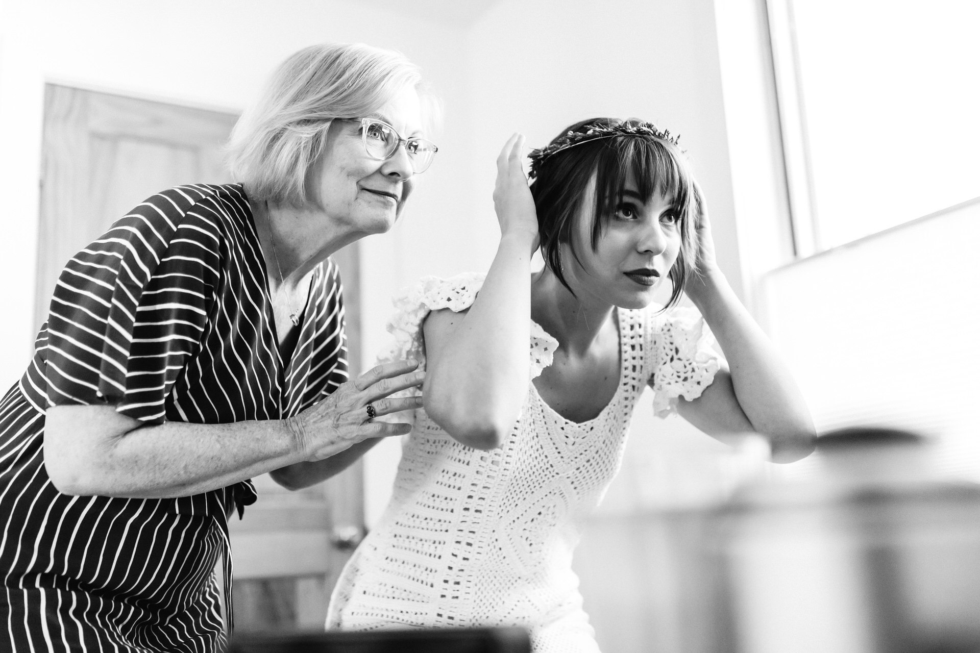 BW Wedding Photographer for Charlottesville, VA | putting on the finishing touches