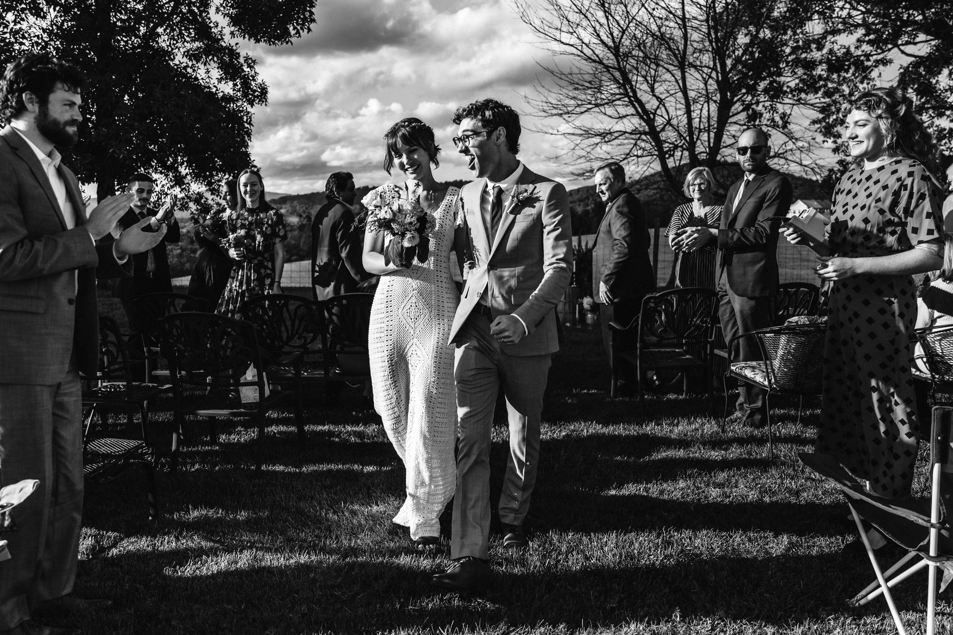 Photographer of Charlottesville Weddings | the couple processing after the ceremony