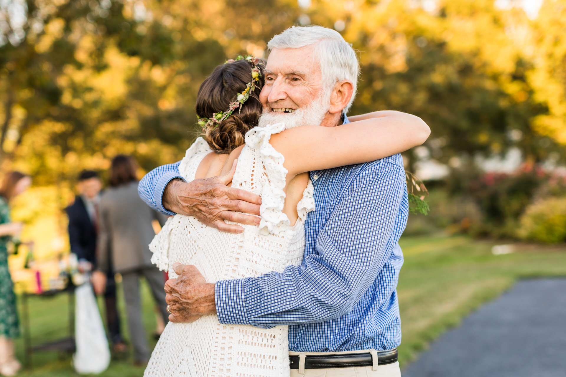 Charlottesville Virginia Wedding Photographers | The bride gives her grandfather the biggest hug