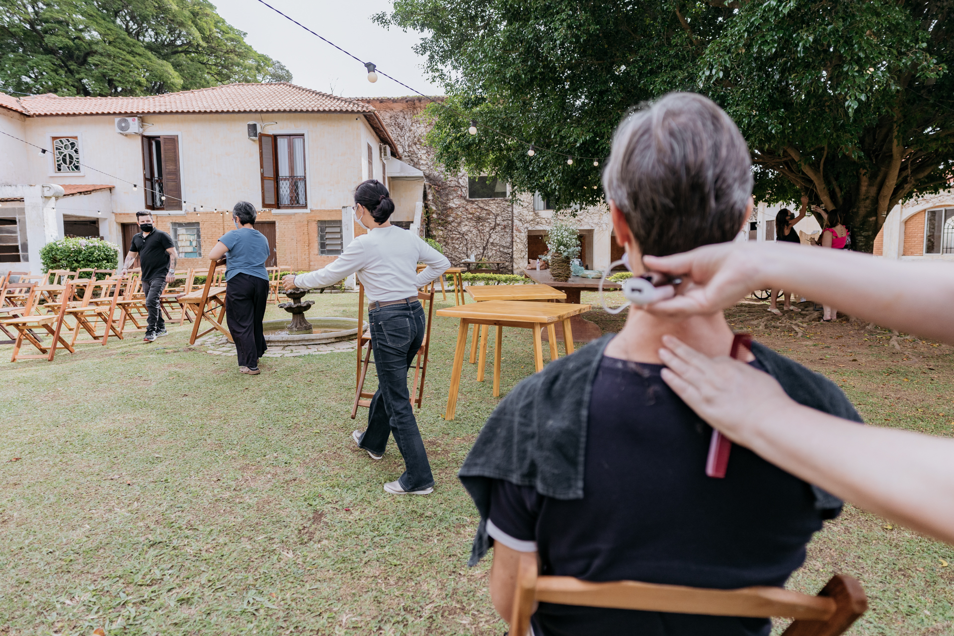 Hotel Fazenda Pictures at Maristela - Brazil Weddings | The groom sits down for a quick trim