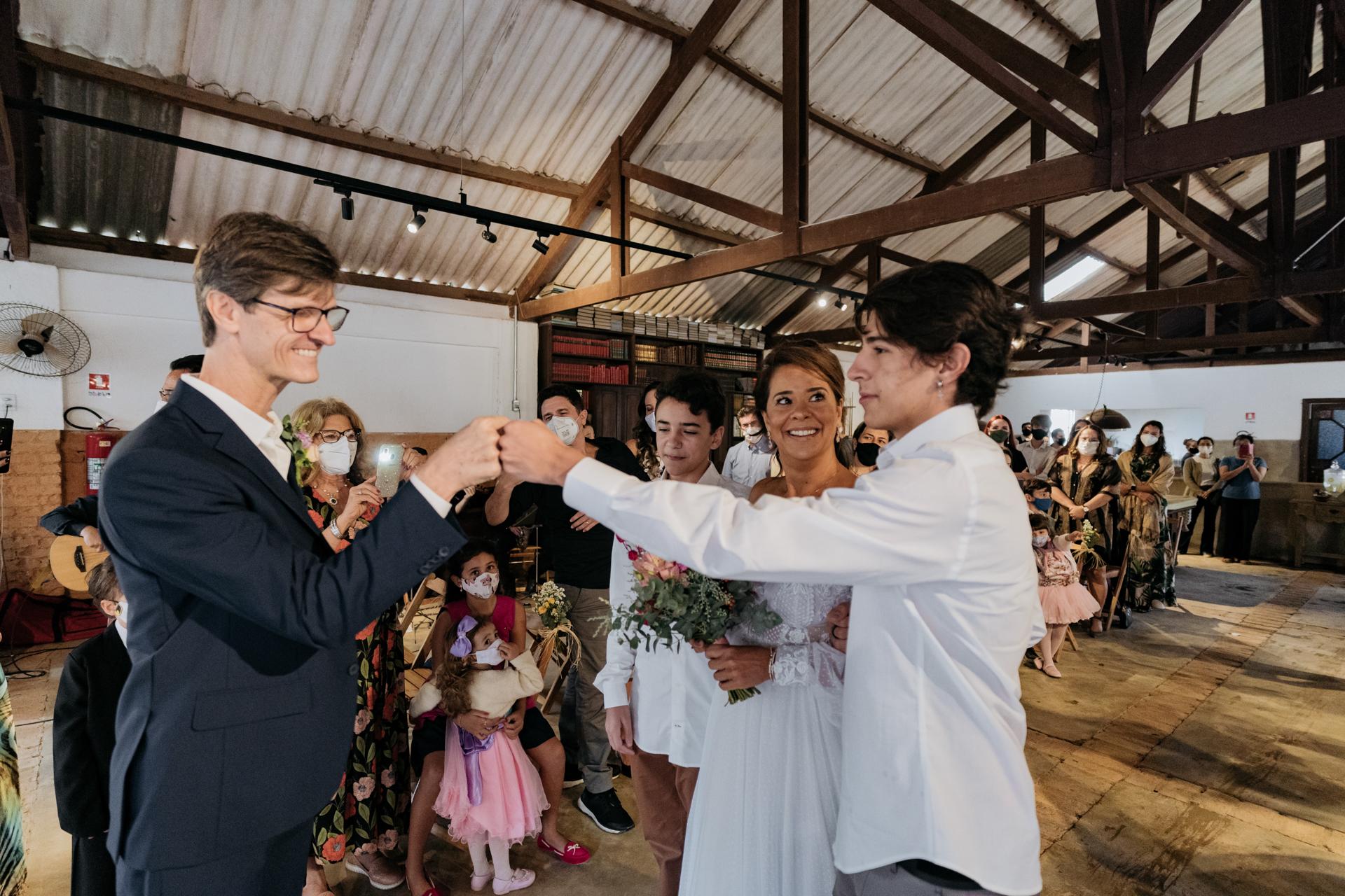Weddings at Maristela Farm, Sao Paulo Brazil Photography | The groom gives the bride's son a fist bump