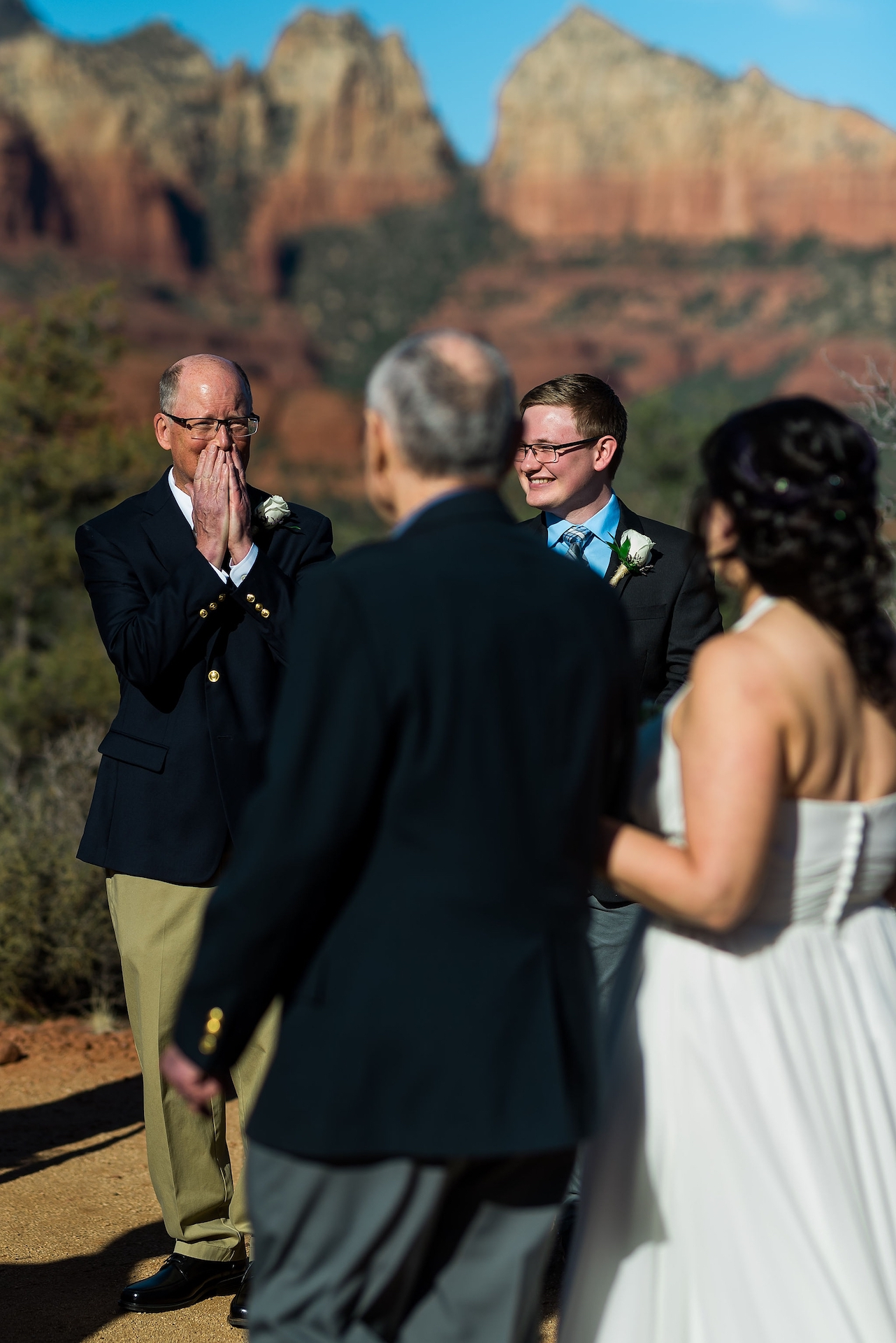 Outdoor Wedding Venue Pictures in Sedona, AZ | The groom reacts to seeing the bride for the first time