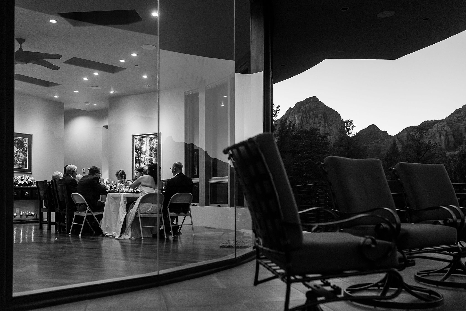 Sedona, Arizona Private Home Wedding Image in BW |  The family enjoys an intimate dinner together