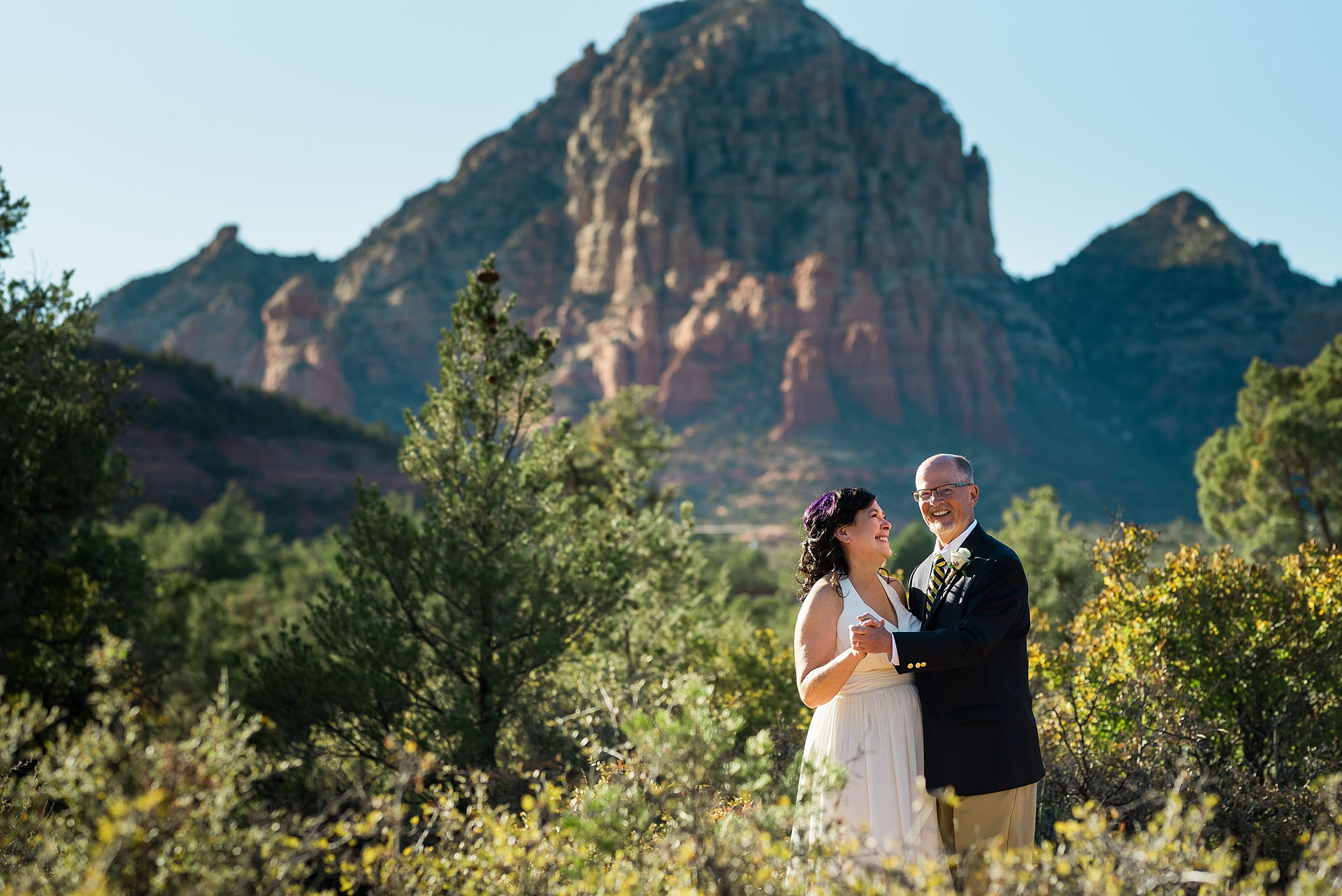 Sedona Parks and Recreation Land Wedding Couple Portrait | The newlyweds share a minute together outdoors