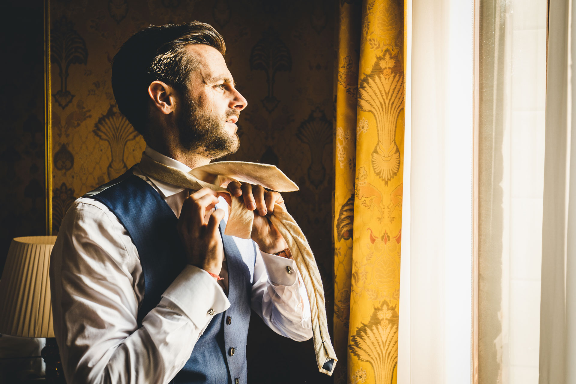 Bauer Palazzo Venice, Italy Wedding Photographer | The groom looks out to the city below