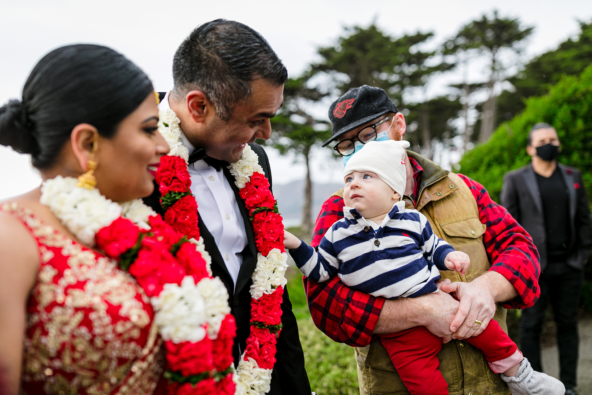 Dramatic Overlook Wedding Pic at Golden Gate | The happy couple takes a few minutes to greet guests