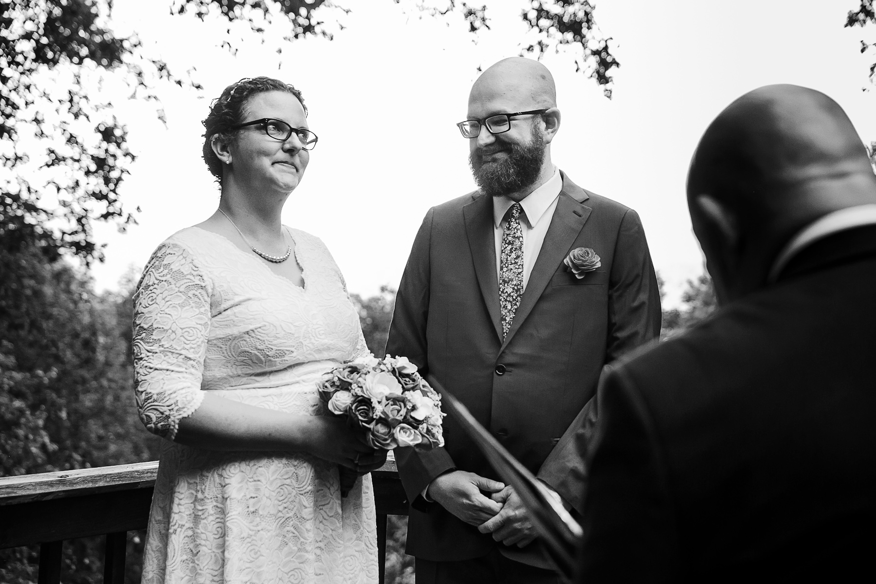 Outdoor Wedding Photography in Georgia | the officiant makes the bride ponder