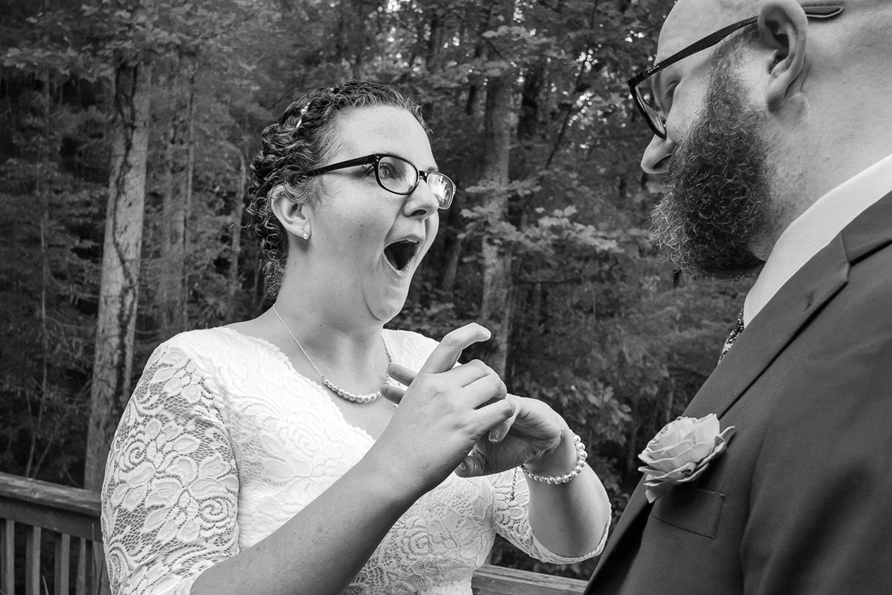 Atlanta, GA Wedding Image | the bride reacts after reading the ring inscription