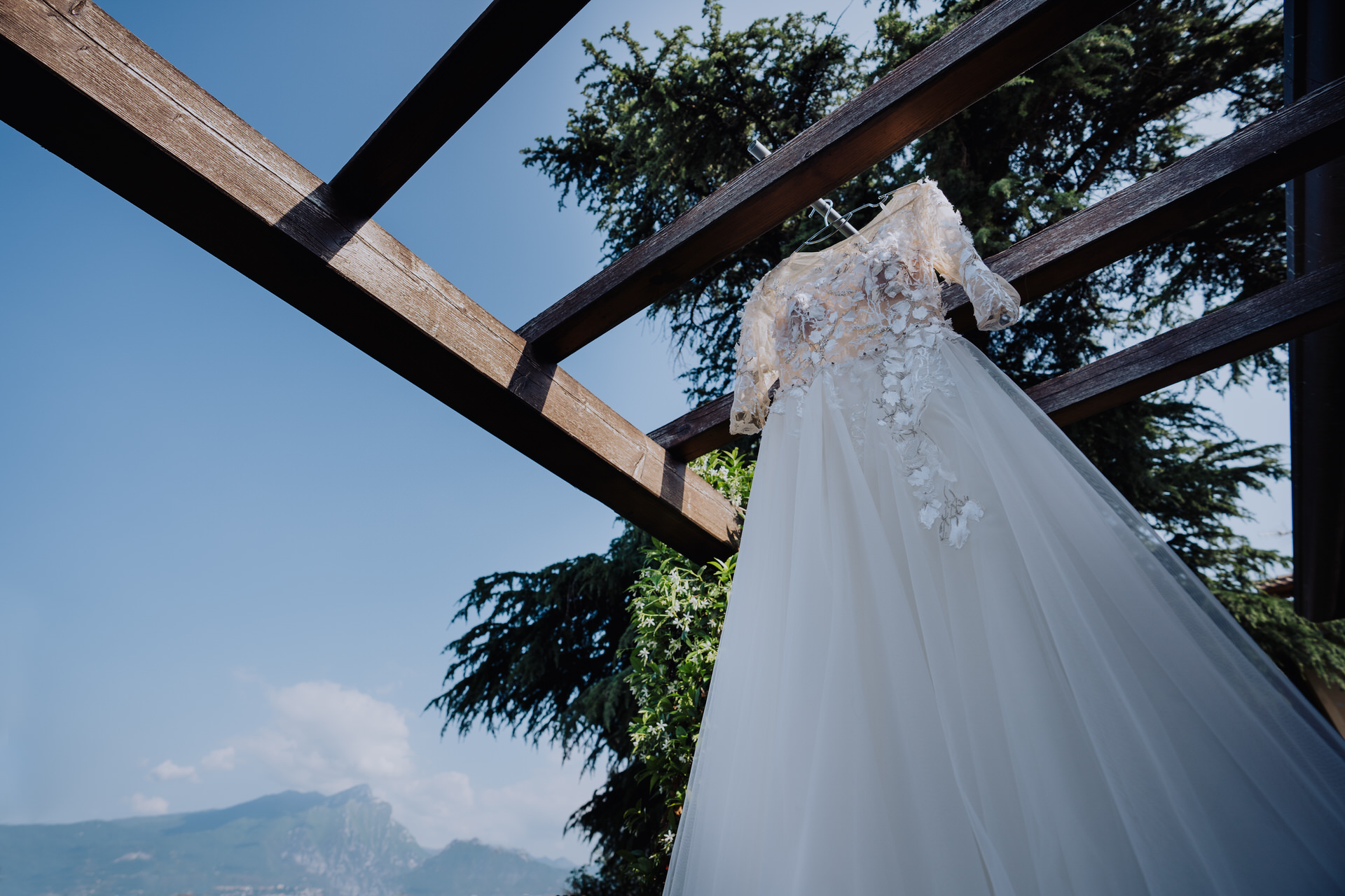 Destination Wedding Image from Torri del Benaco   The brides stunning wedding gown hangs from the pergola