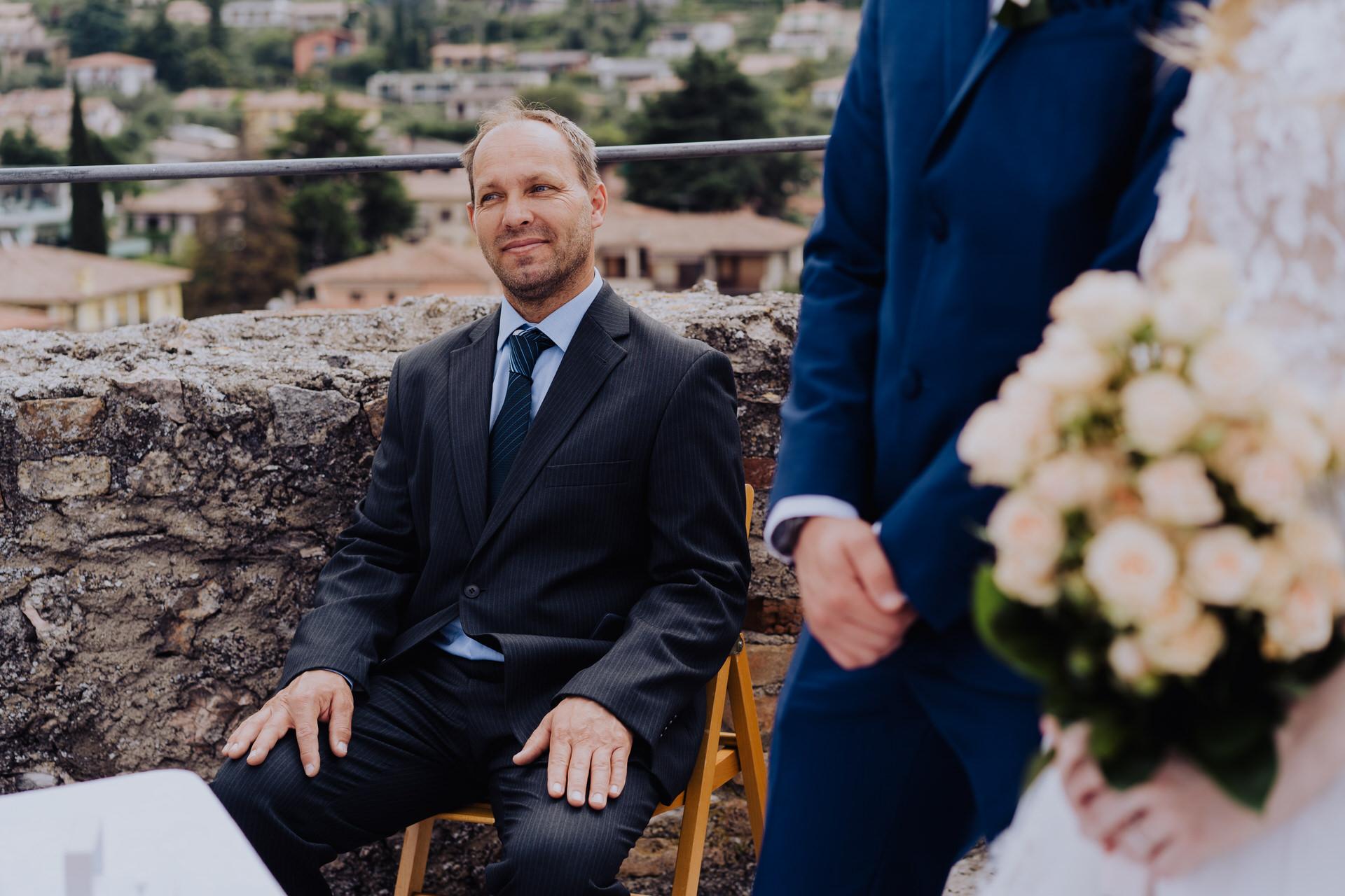 Lake Garda Weddings - Italian Photographers   A witness at the wedding smiles as he soaks up the magnitude