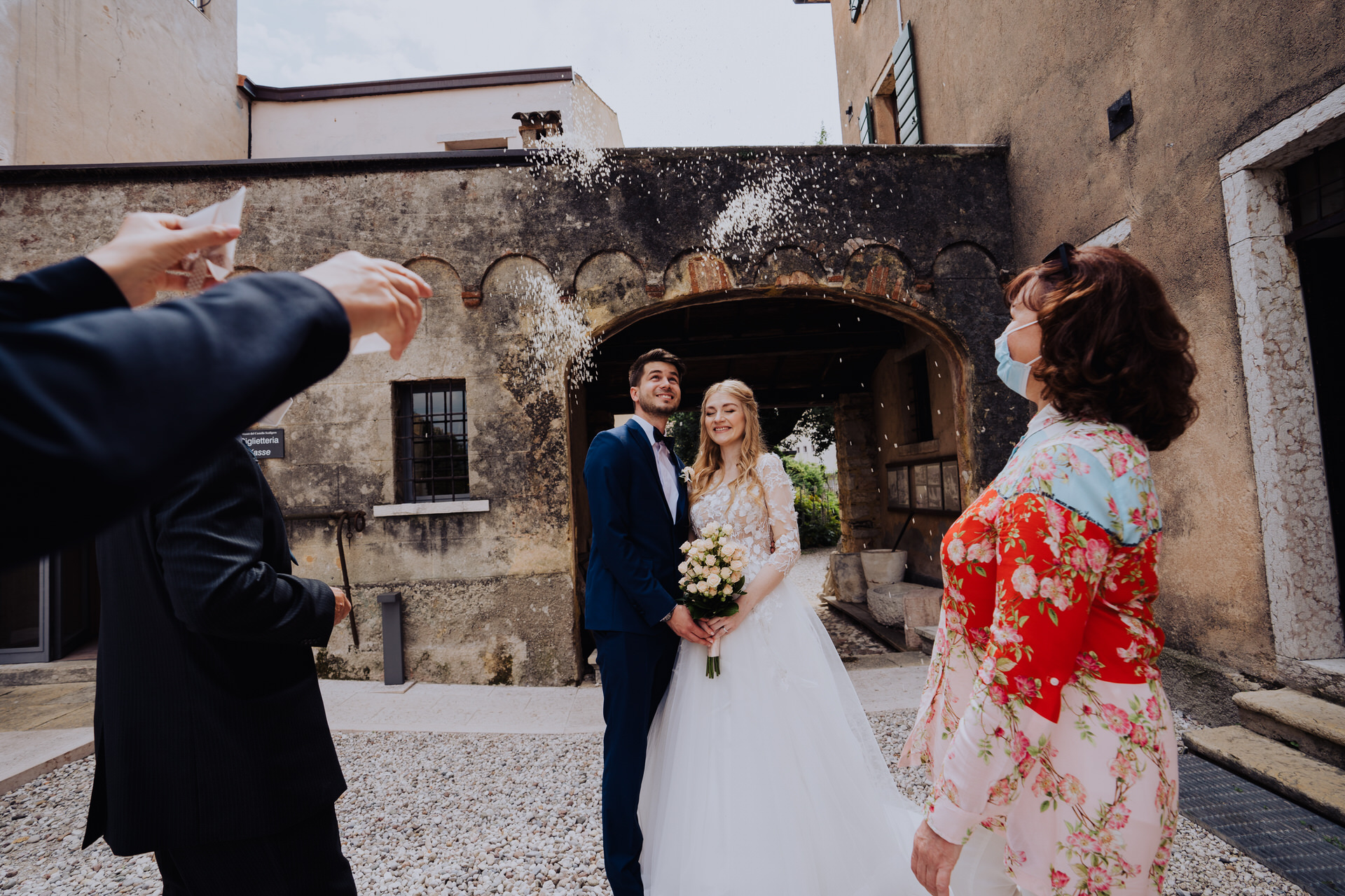 Wedding Pic from Torri Del Benaco - Italy Couples   Not wanting to miss out on tradition, guests toss rice