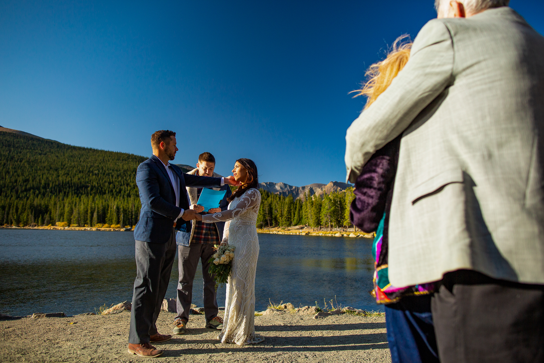 Mount Evans Summit Outdoor Ceremony Photos   A tender touch from the groom as he wipes away a tear