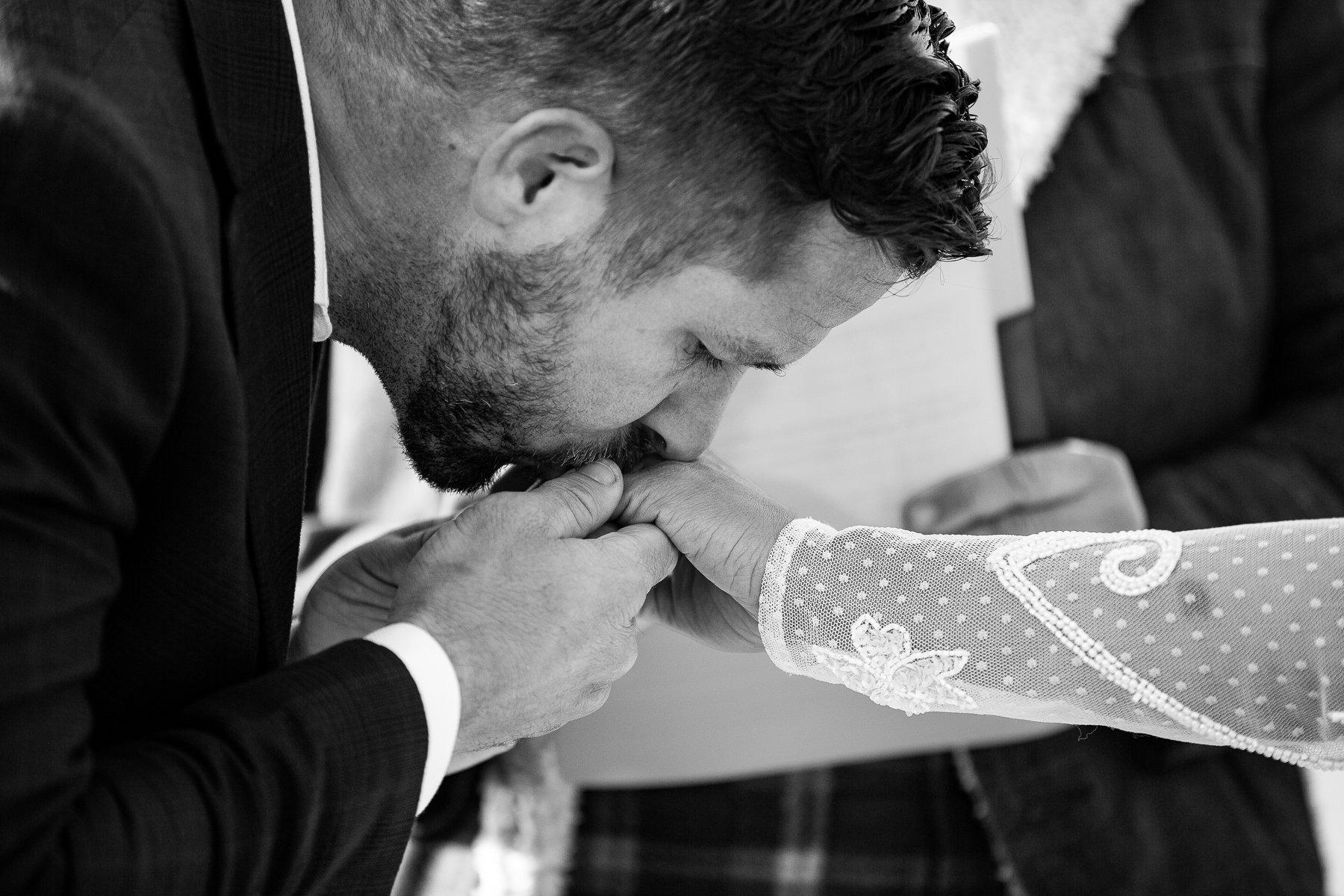 Colorado Outdoor Ceremony Photo Detail in BW   slipping the ring on her finger