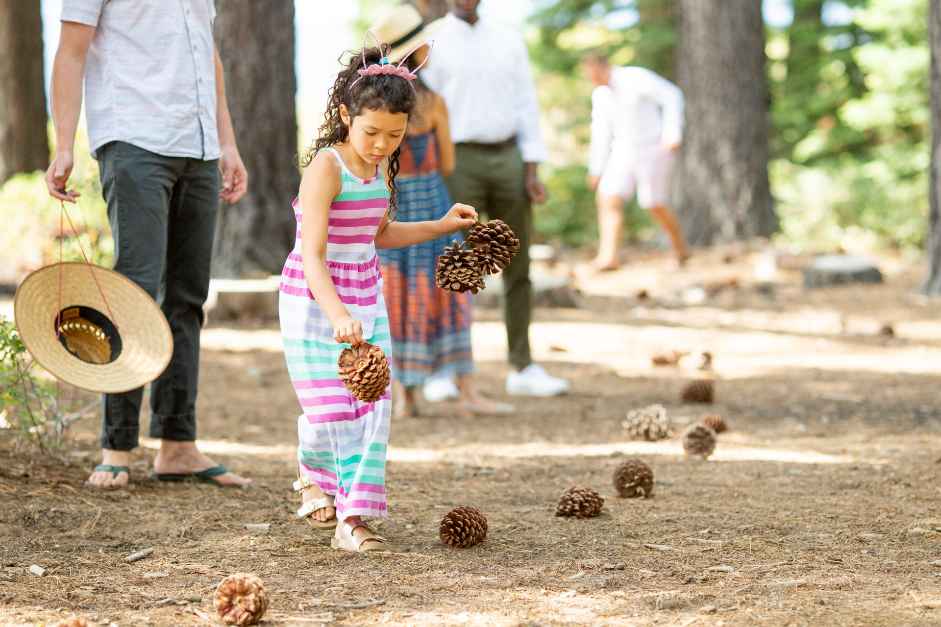 Tahoe Wedding Photography from Outdoors at Skylandia Park   The kids gathered pine cones to create a pathway for the bride to walk down