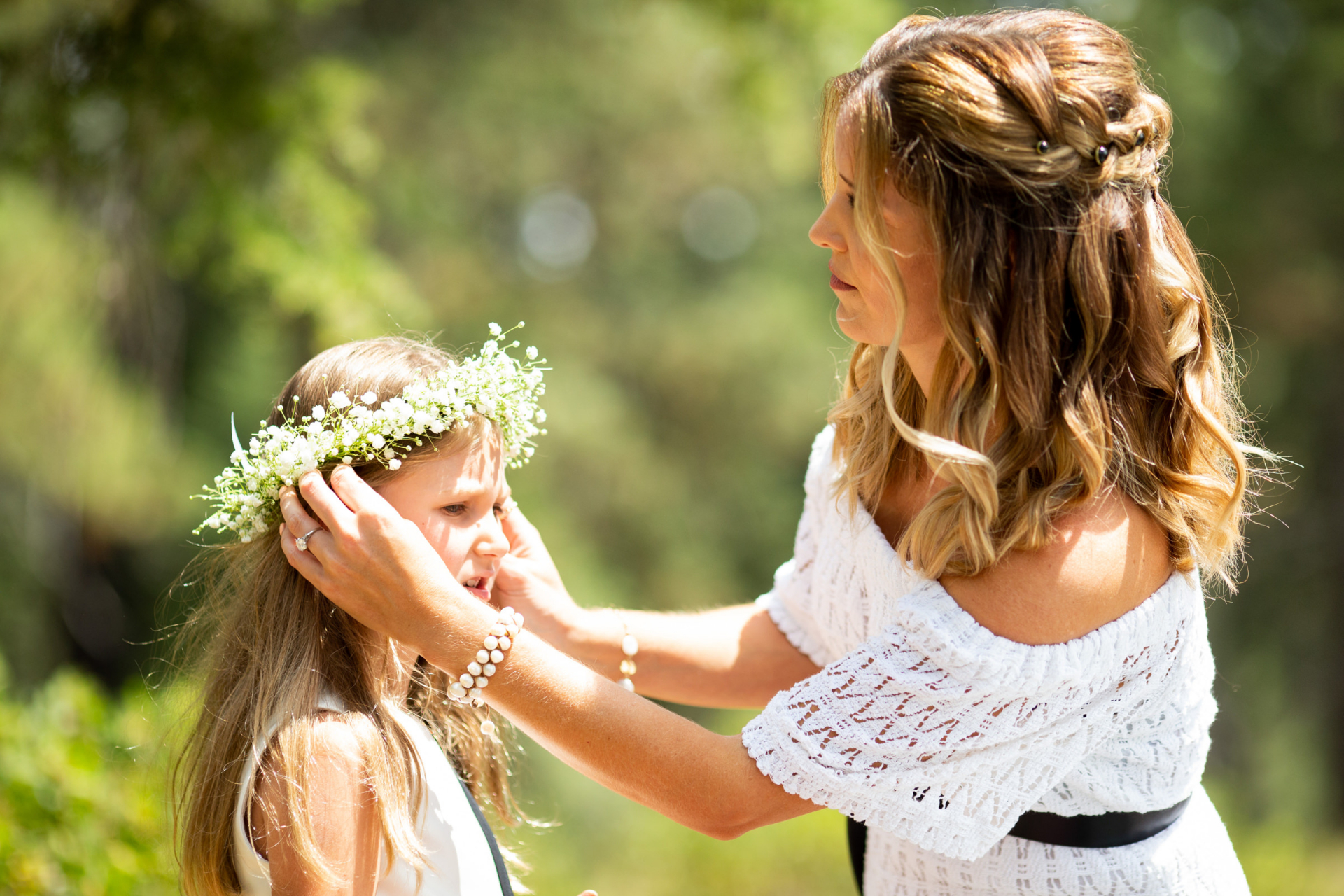 Skylandia Beach Park Wedding Images from Tahoe City   The flower girl gets her flower crown or wreath fixed on her head by the bride-to-be