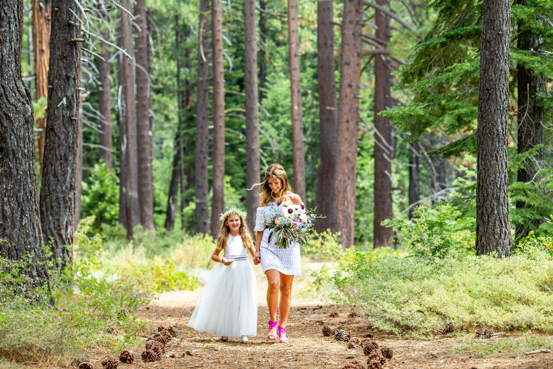 Outdoor Wedding Photography - Skylandia Park Lake Tahoe, CA   The bride-to-be and the flower girl make their way down the path