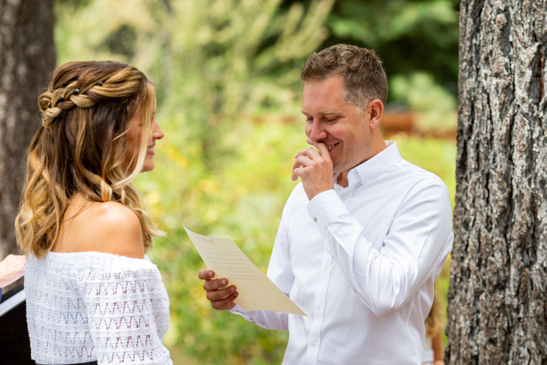 Outdoor Wedding Ceremony Image -  Skylandia Park Lake Tahoe   A funny moment happens between the bride and groom